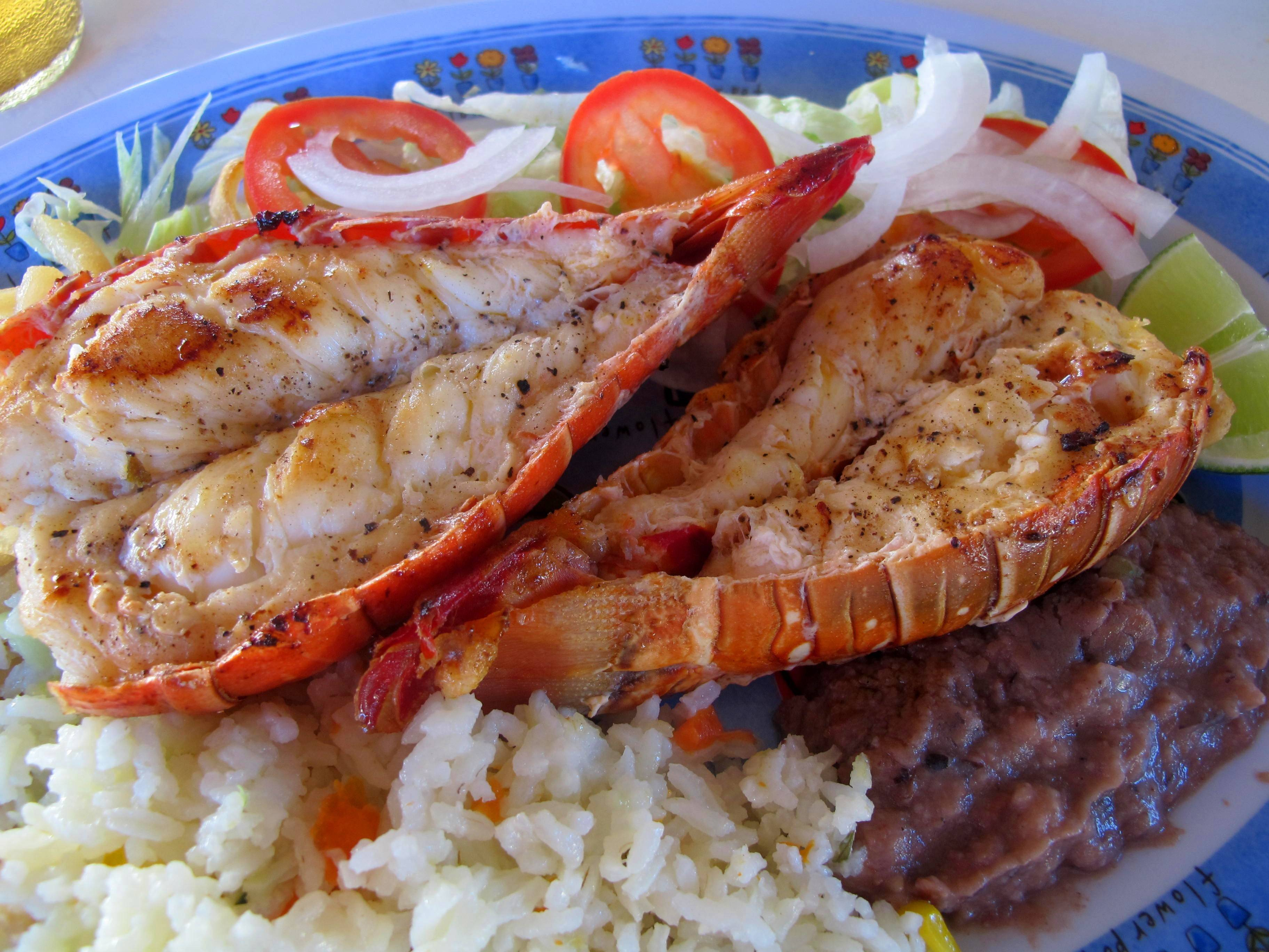 Try fresh grilled lobster at a popular lunch spot known as Velasquez Restaurant in Isla Mujeres, Mexico.