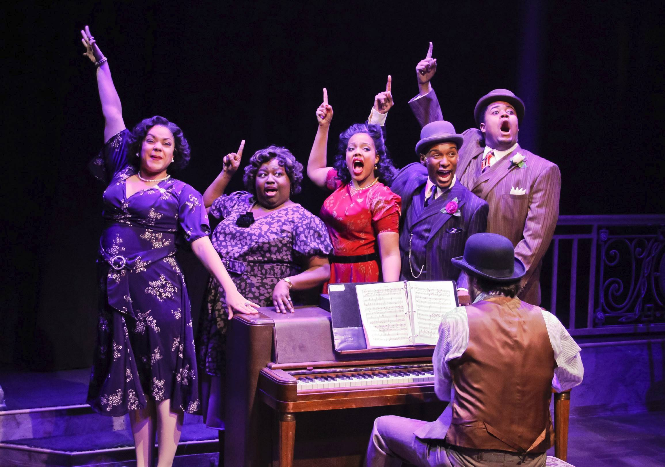 "Accompanied by pianist/conductor Austin Cook, seated, Lina Wass, standing from left, Robin DaSilva, Sharriese Hamilton, Donterrio Johnson and Lorenzo Rush, Jr., sizzle in Porchlight Music Theatre's revival of the Fats Waller tribute ""Ain't Misbehavin'."""
