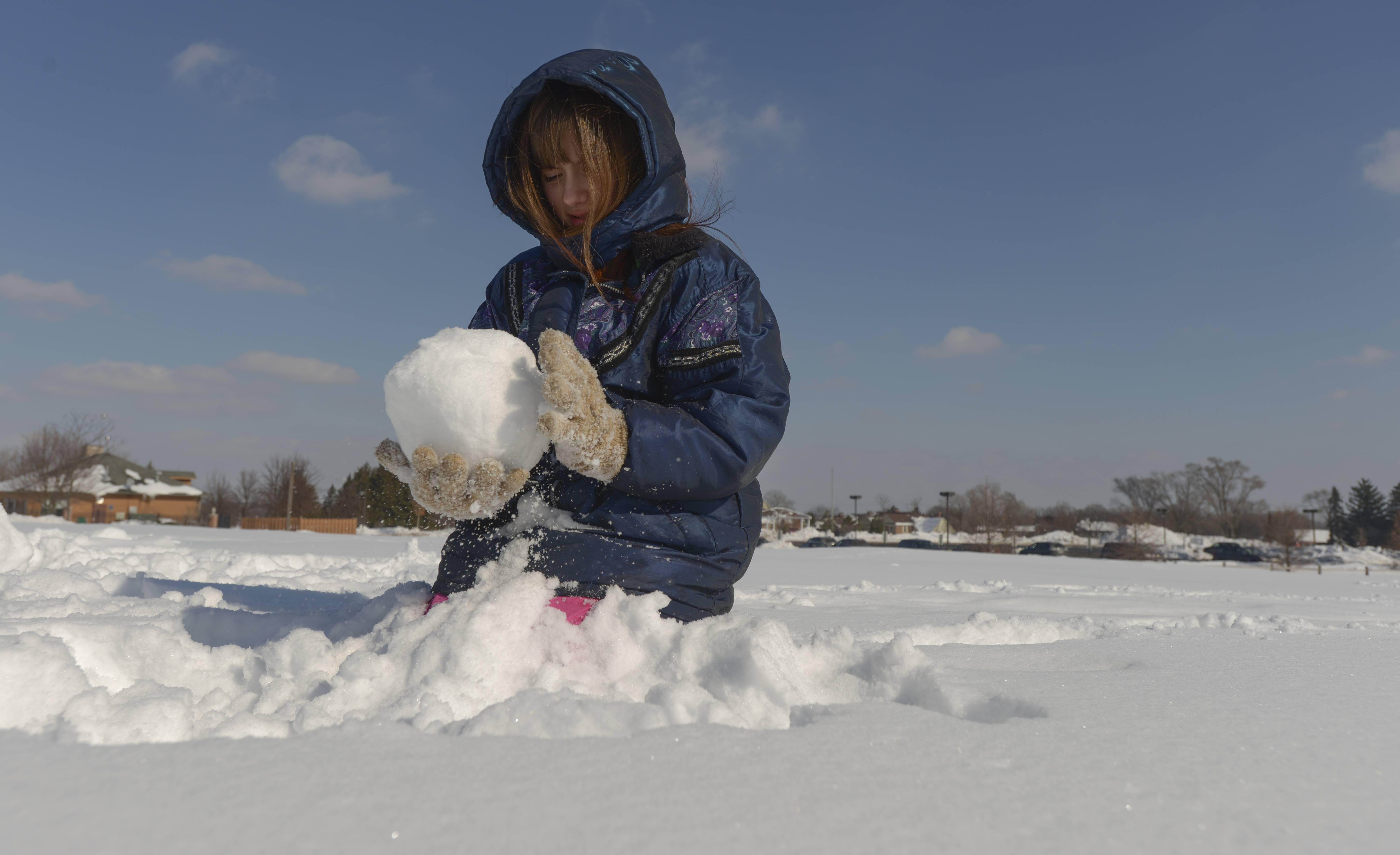 Tessa-Kay Stahulak, 11, of Wheaton works on building a Mickey Mouse snowman Sunday during the Glen Ellyn Park District's 2nd annual Arctic Blast event at Maryknoll Park.