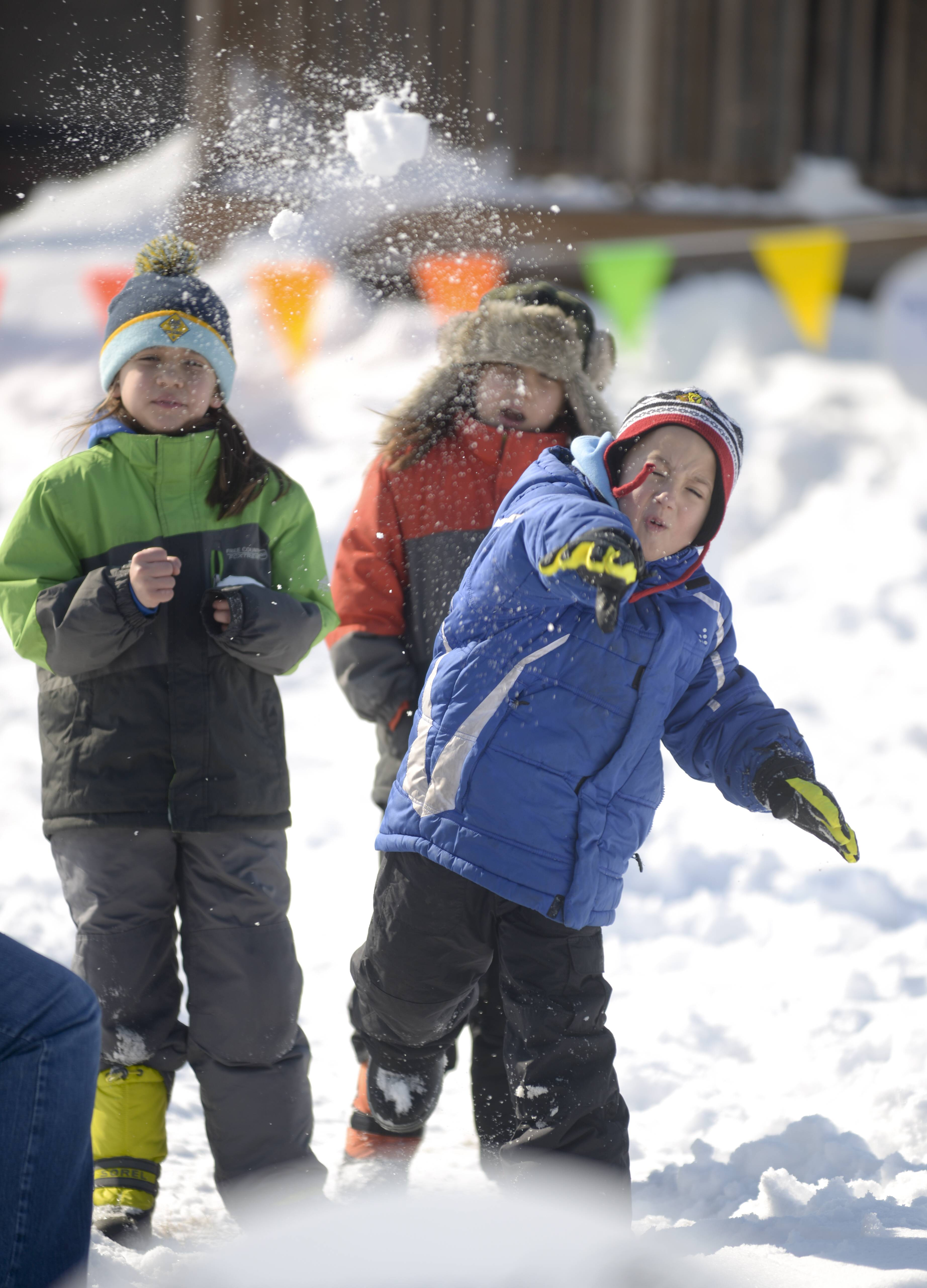 Daniel Jirsa, 9, of Wheaton tries out the snowball toss Sunday at the Glen Ellyn Park District's 2nd annual Arctic Blast event at Maryknoll Park. Daniel was there with other members of Wheaton's Cub Scout Pack 317.