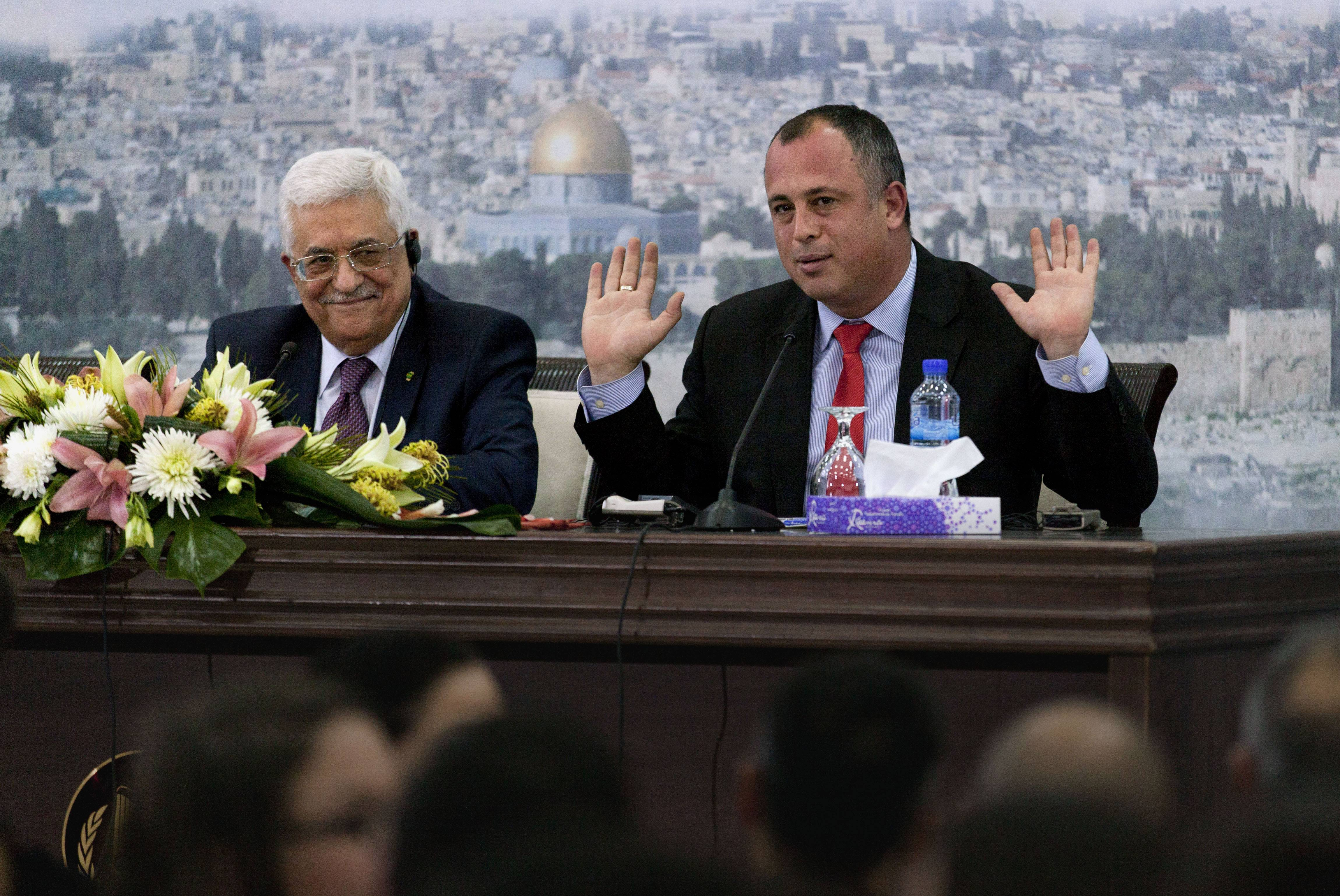 "Palestinian President Mahmoud Abbas, left and Israeli Labor party lawmaker Hilik Bar attend a meeting with a delegation of mostly Israeli university students and activists at the presidential headquarters Sunday in the West Bank city of Ramallah. Abbas said that he does not want to ""drown Israel with millions of (Palestinian) refugees to change its nature."" Abbas' comment Sunday was his most conciliatory yet on the fate of Palestinian refugees who were uprooted from homes in what is now Israel, including in the 1948 war over Israel's creation."