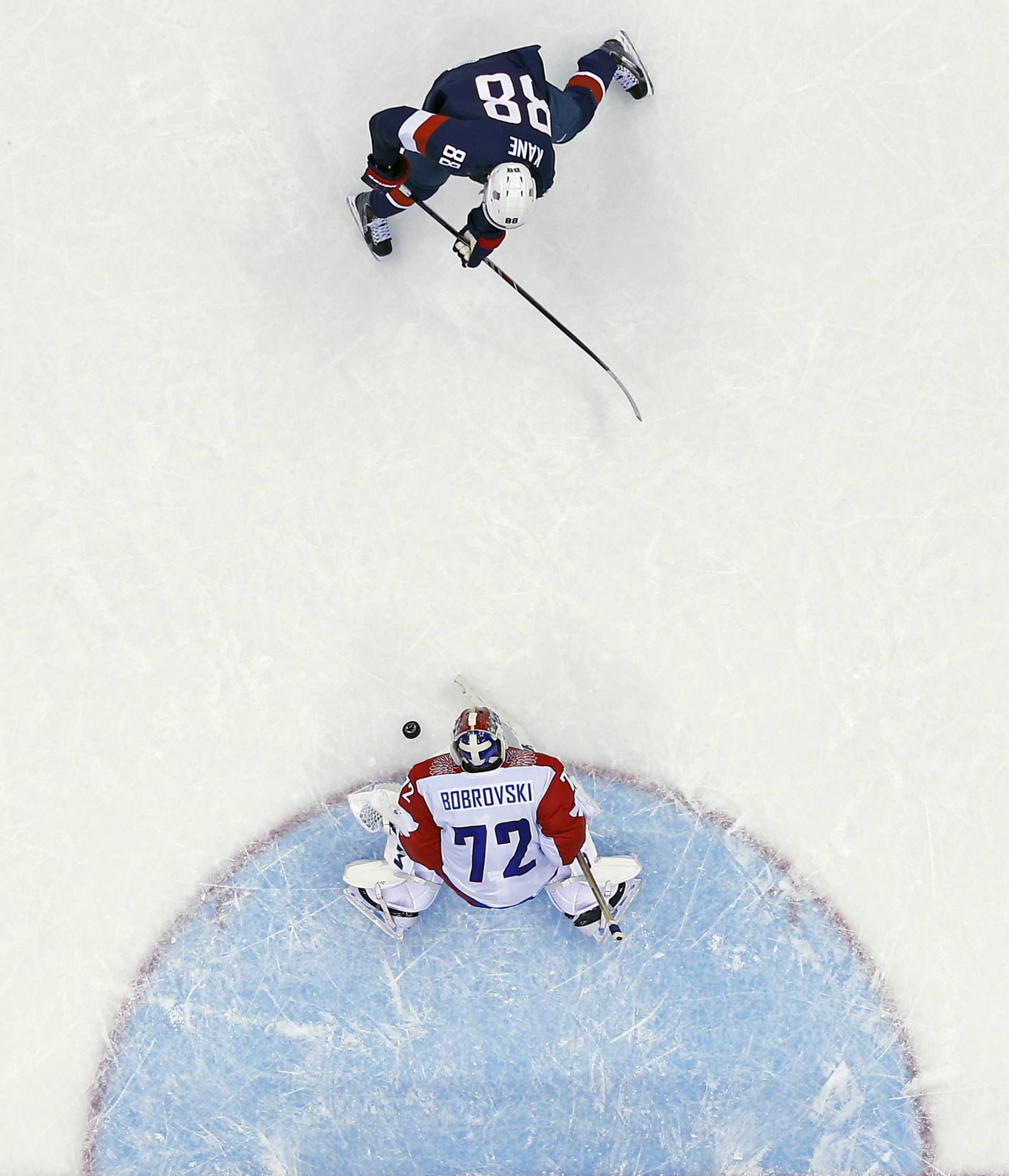 Russia goaltender Sergei Bobrovski stops a breakaway from USA forward Patrick Kane in overtime of a men's ice hockey game at the 2014 Winter Olympics, Saturday, Feb. 15, 2014, in Sochi, Russia.