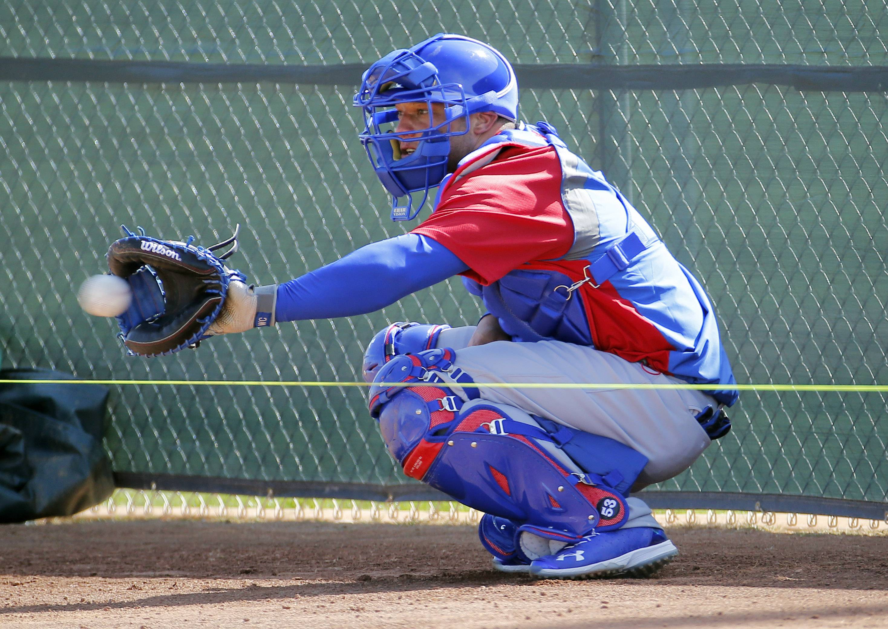 Chicago Cubs catcher Welington Castillo catches during the team's first spring training baseball practice, Friday, Feb. 14, 2014, in Mesa, Ariz.