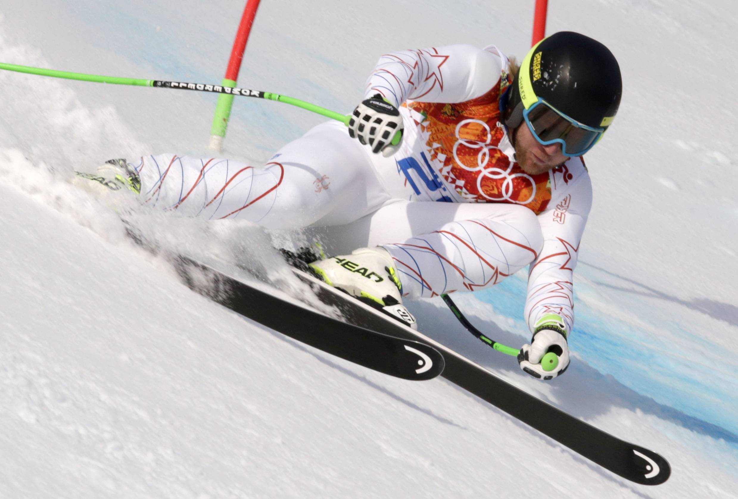 United States' Andrew Weibrecht passes a gate to win the silver medal in the men's super-G at the Sochi 2014 Winter Olympics, Sunday, Feb. 16, 2014, in Krasnaya Polyana, Russia.