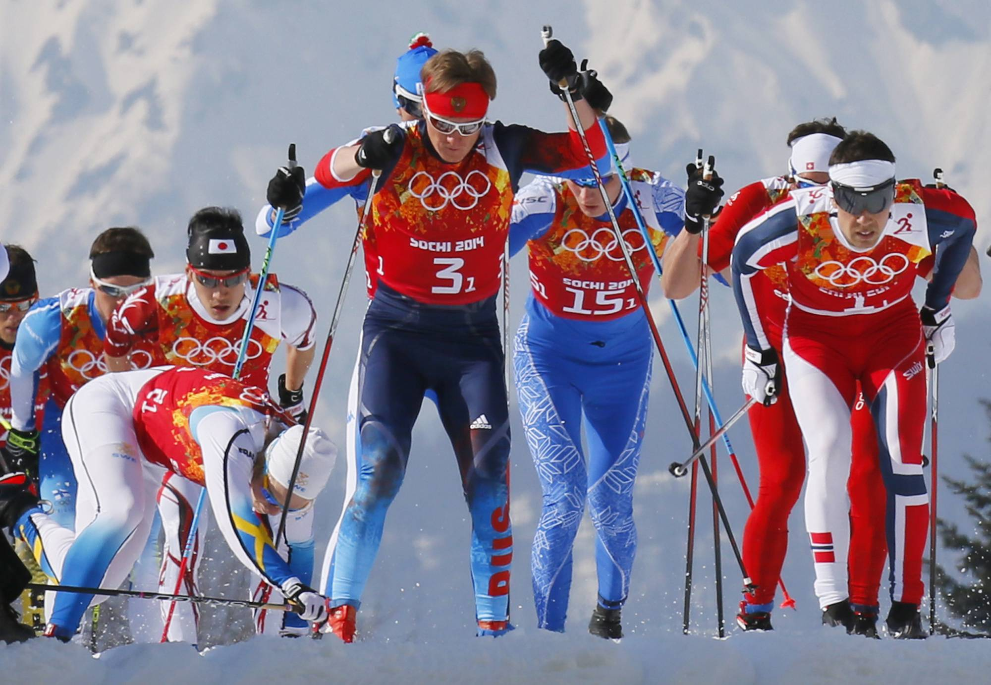 Sweden's Lars Nelson, left, falls during the men's 4x10K cross-country relay at the 2014 Winter Olympics, Sunday, Feb. 16, 2014, in Krasnaya Polyana, Russia.