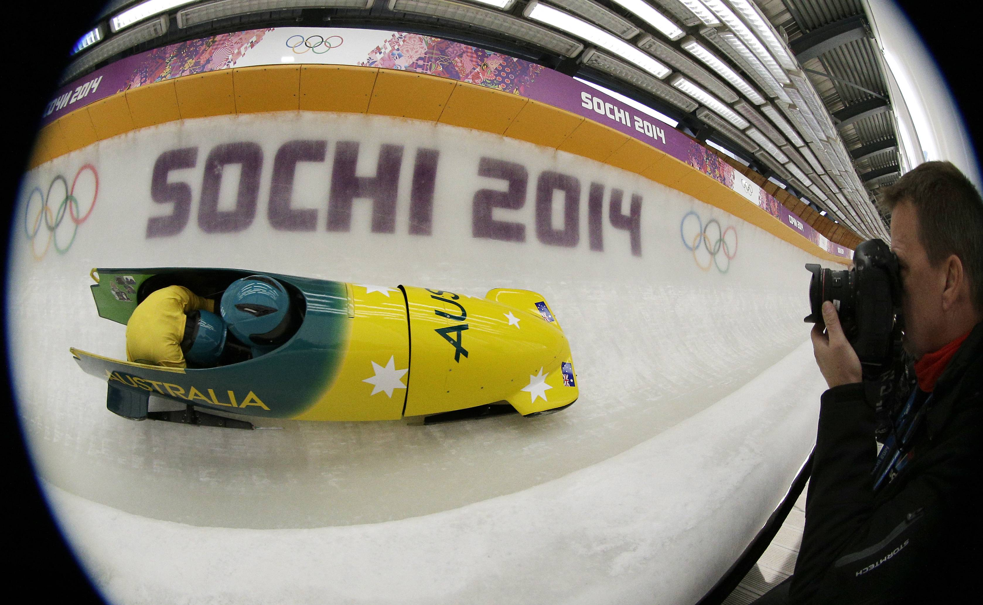 In this image taken with a fisheye lens, Astrid Radjenovic of Australia takes a turn during a training session for the women's bobsled at the 2014 Winter Olympics, Sunday, Feb. 16, 2014, in Krasnaya Polyana, Russia.