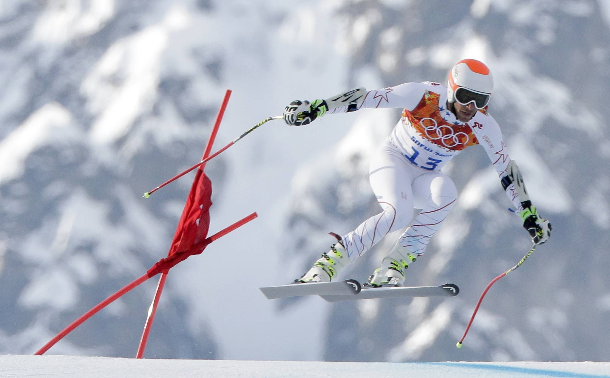 Joint bronze medal winner Bode Miller of the United States makes a jump in the men's super-G at the Sochi 2014 Winter Olympics, Sunday, Feb. 16, 2014, in Krasnaya Polyana, Russia.