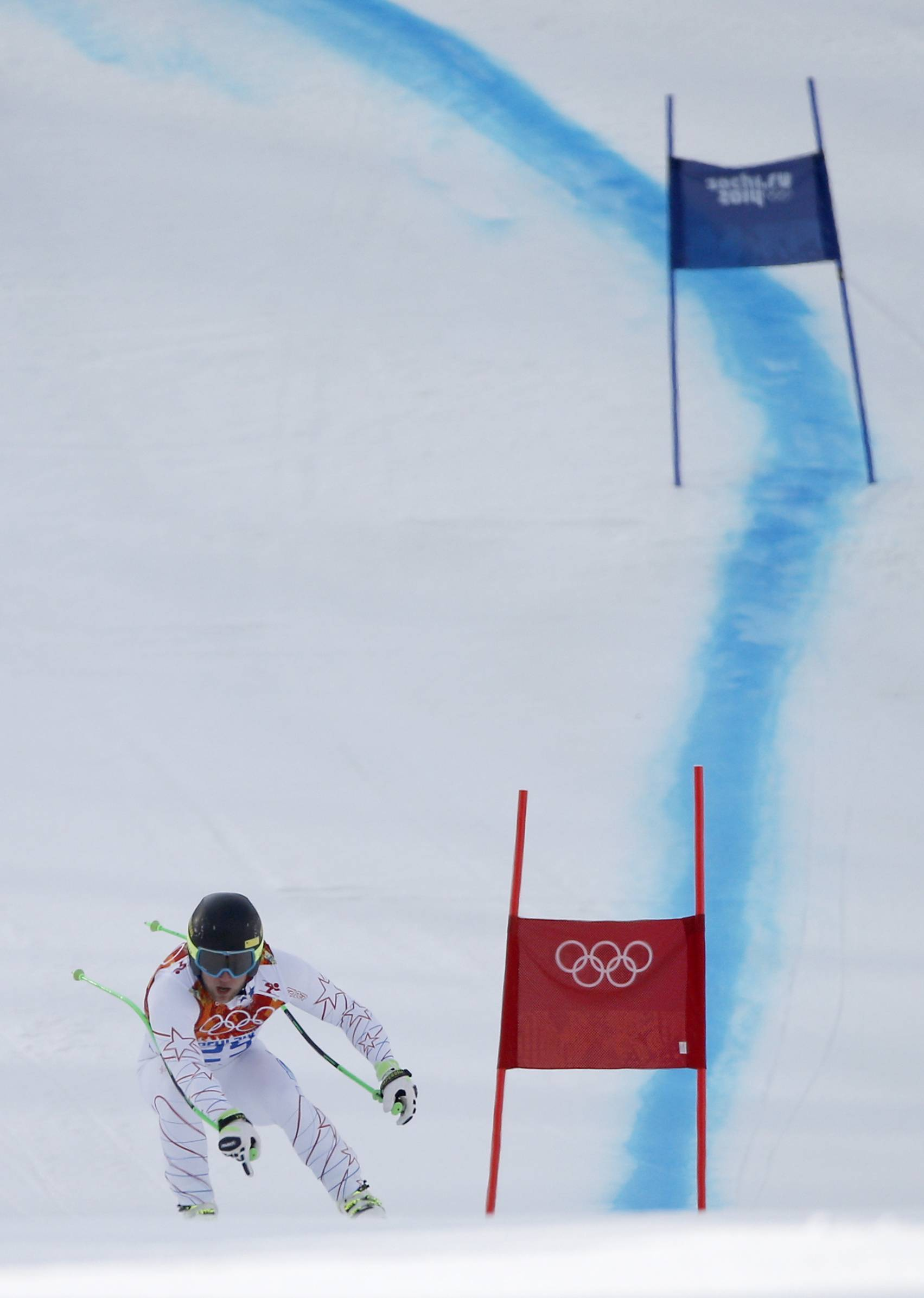 United States' Andrew Weibrecht passes a gate near the finish line on his way to taking the silver medal in the men's super-G at the Sochi 2014 Winter Olympics, Sunday, Feb. 16, 2014, in Krasnaya Polyana, Russia.