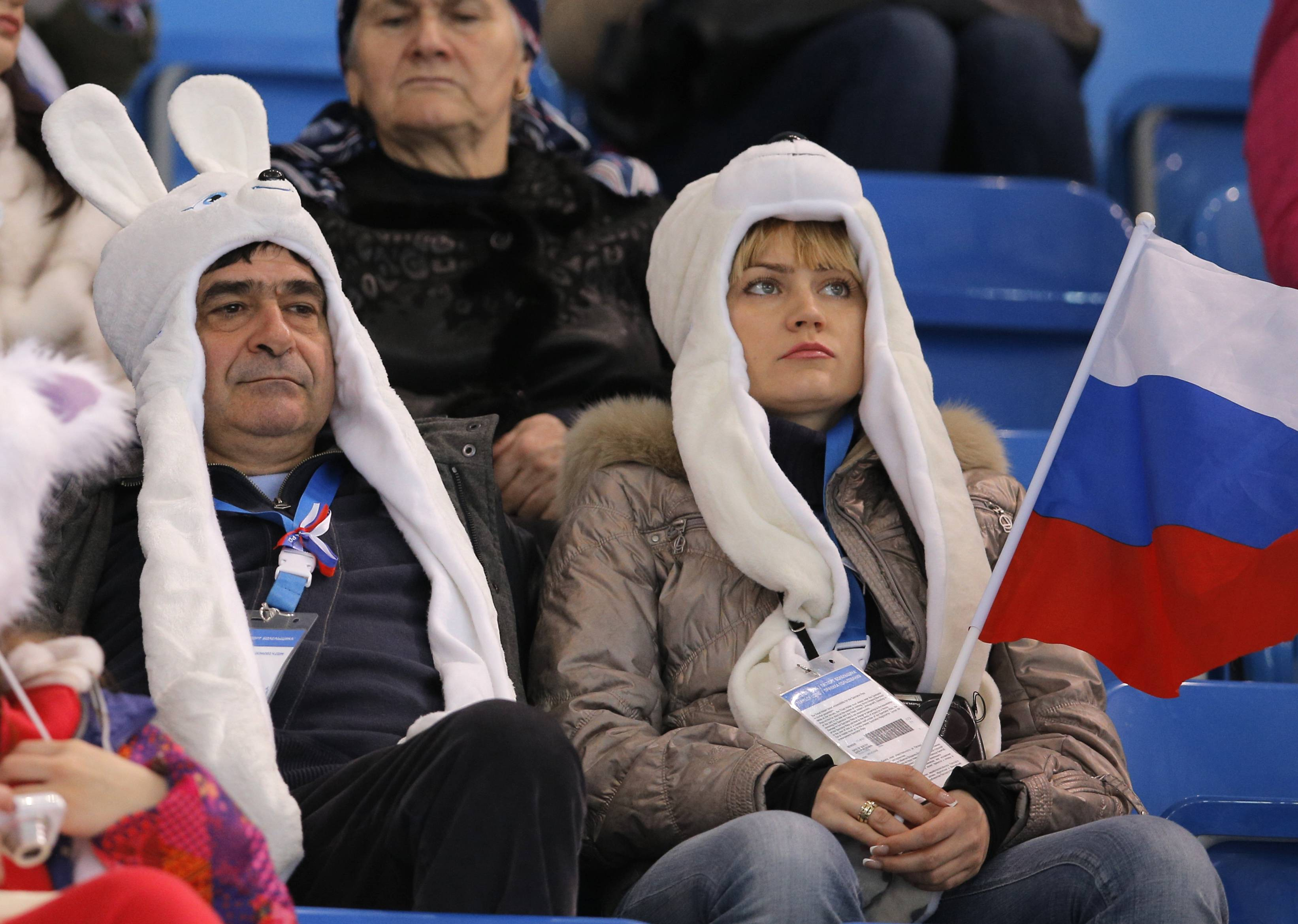 Spectators wait for the start of the ice dance short dance figure skating competition at the Iceberg Skating Palace during the 2014 Winter Olympics, Sunday, Feb. 16, 2014, in Sochi, Russia.