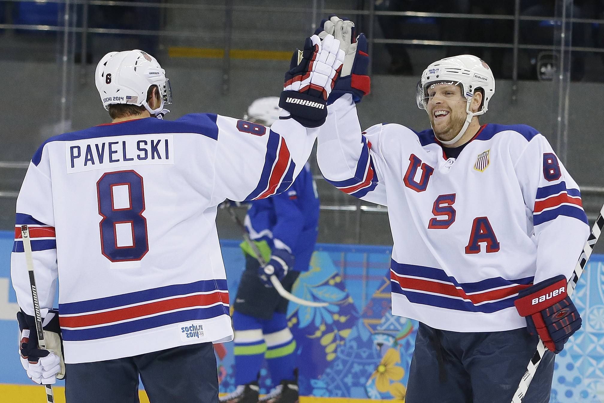 USA forward Phil Kessel, right, celebrates his second goal with teammate Joe Pavelski during the 2014 Winter Olympics men's ice hockey game against Slovenia at Shayba Arena Sunday, Feb. 16, 2014, in Sochi, Russia.