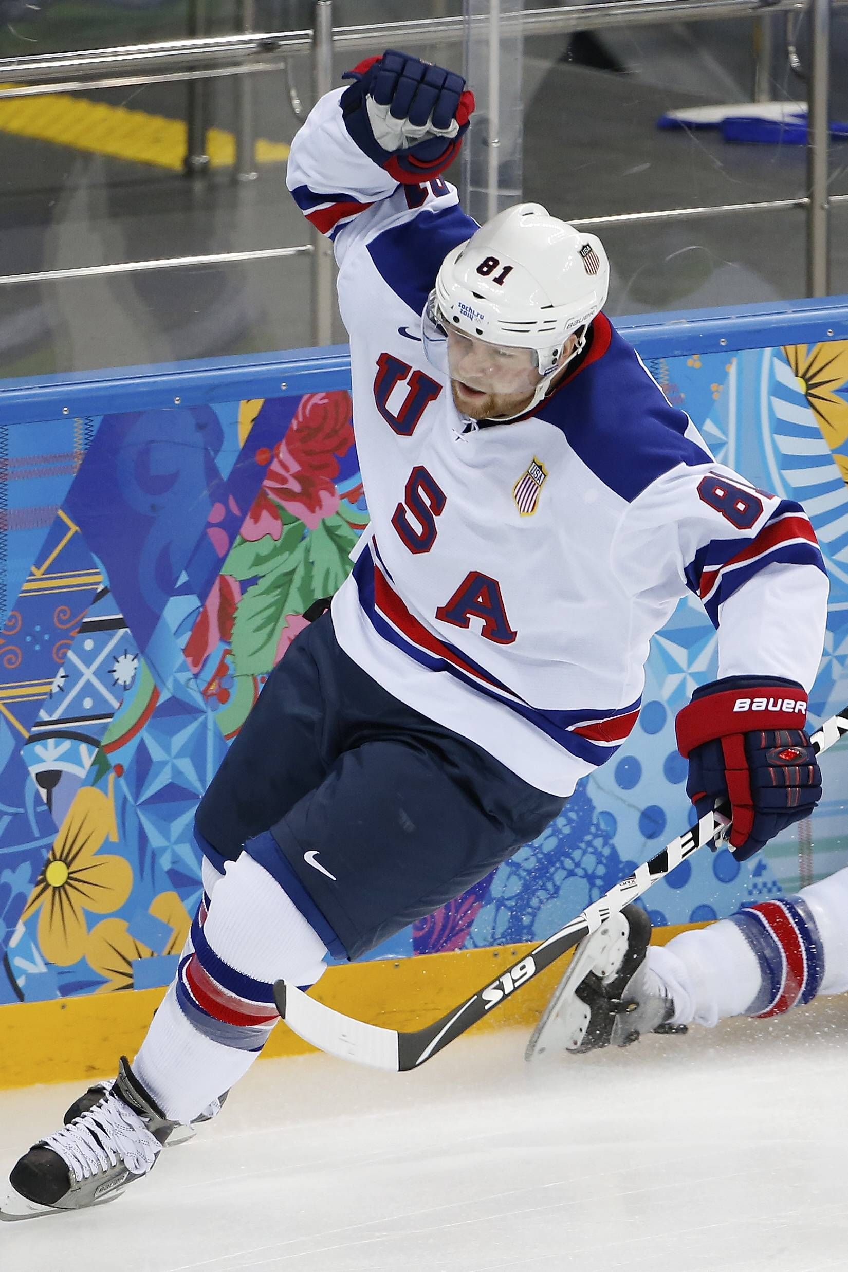 USA forward Phil Kessel celebrates his goal against Slovenia during the 2014 Winter Olympics men's ice hockey game at Shayba Arena Sunday, Feb. 16, 2014, in Sochi, Russia.