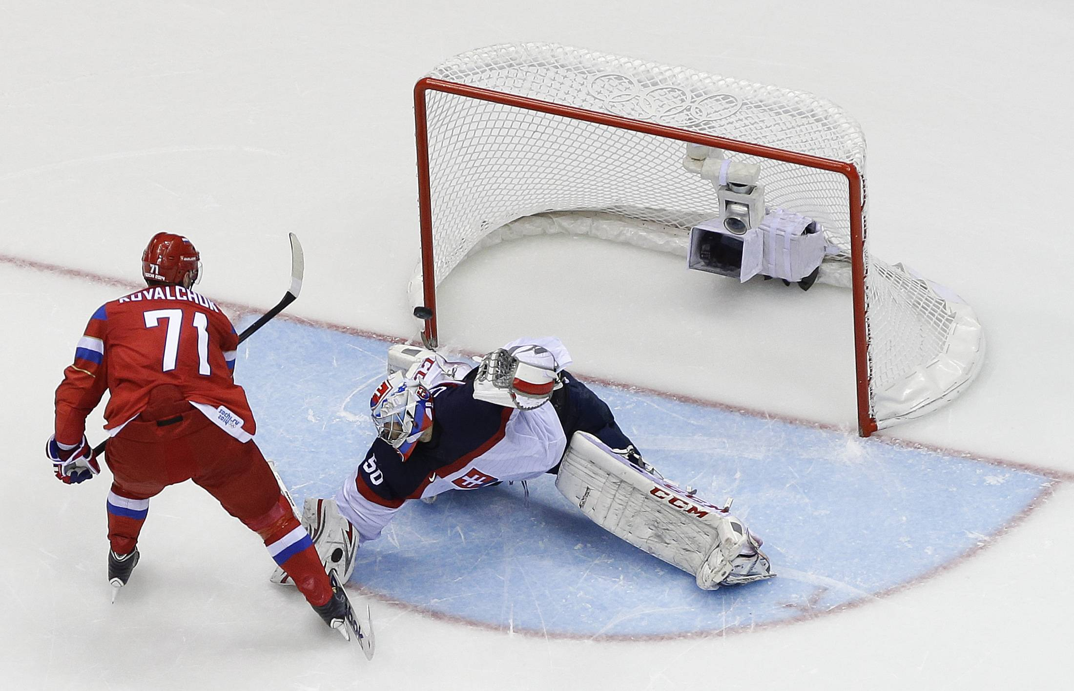 Russia forward Ilya Kovalchuk flips the puck past Slovakia goaltender Jan Laco to win a shootout during a men's ice hockey game at the 2014 Winter Olympics, Sunday, Feb. 16, 2014, in Sochi, Russia. Russia won 1-0.