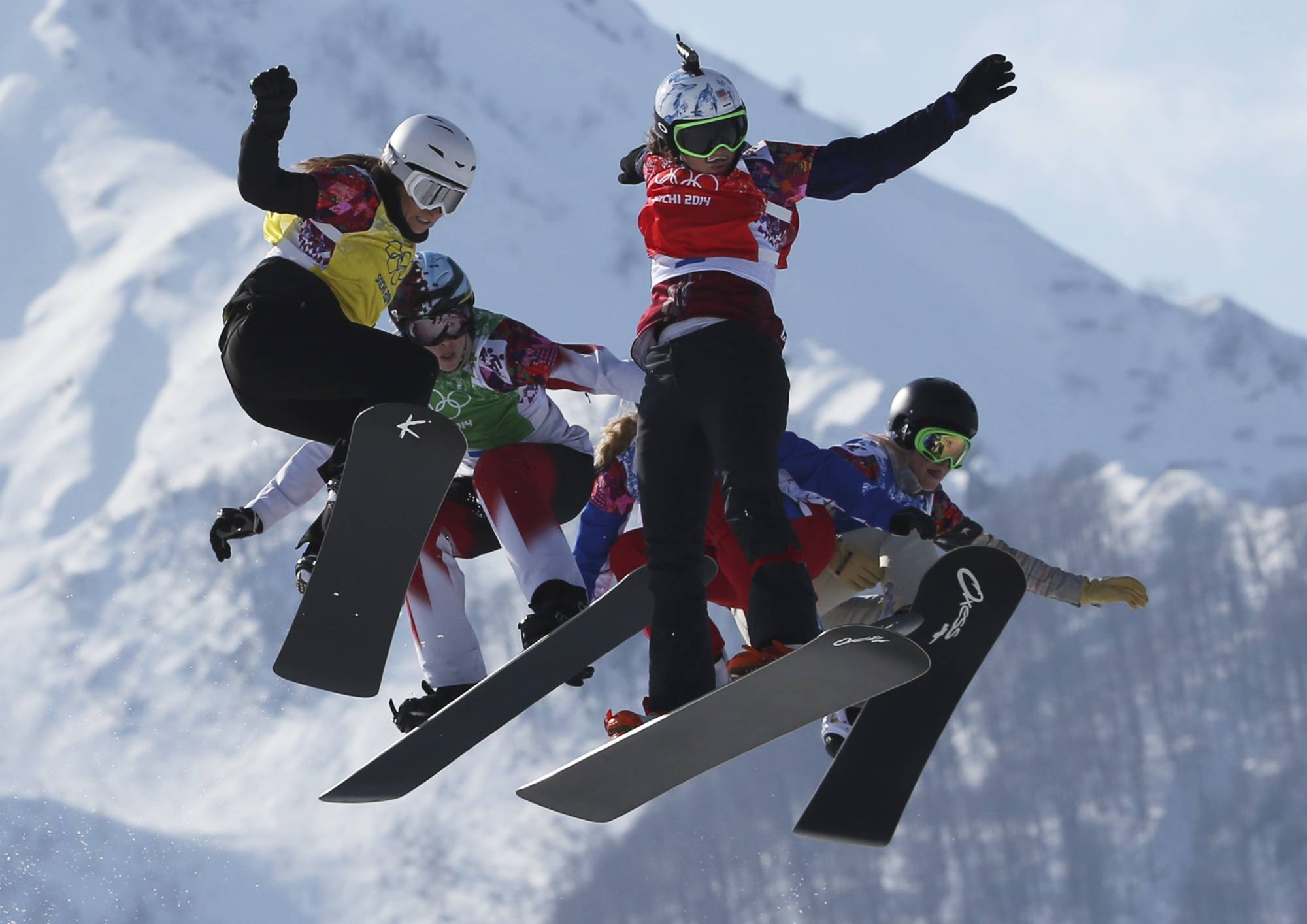 Czech Republic's Eva Samkova, second right, leads the field in the women's snowboard cross final at the Rosa Khutor Extreme Park, at the 2014 Winter Olympics, Sunday, Feb. 16, 2014, in Krasnaya Polyana, Russia. Samkova went on to win the gold medal. The other boarders are, from left, Bulgaria's Alexandra Jekova, Canada's Dominique Maltais, France's Chloe Trespeuch (obscured), and United States' Faye Gulini.