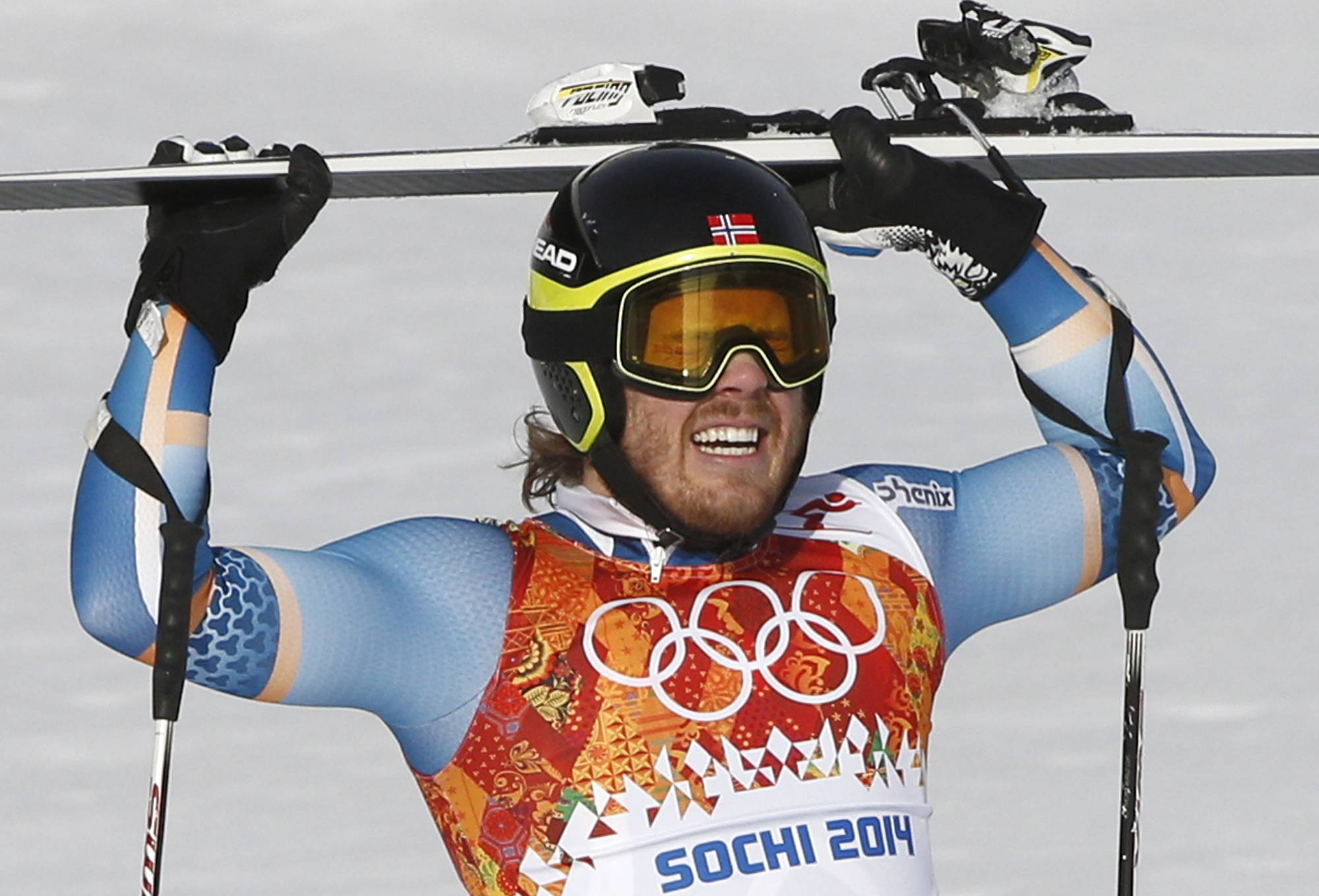 Norway's Kjetil Jansrud celebrates his first-place finish in the men's super-G at the Sochi 2014 Winter Olympics, Sunday, Feb. 16, 2014, in Krasnaya Polyana, Russia.