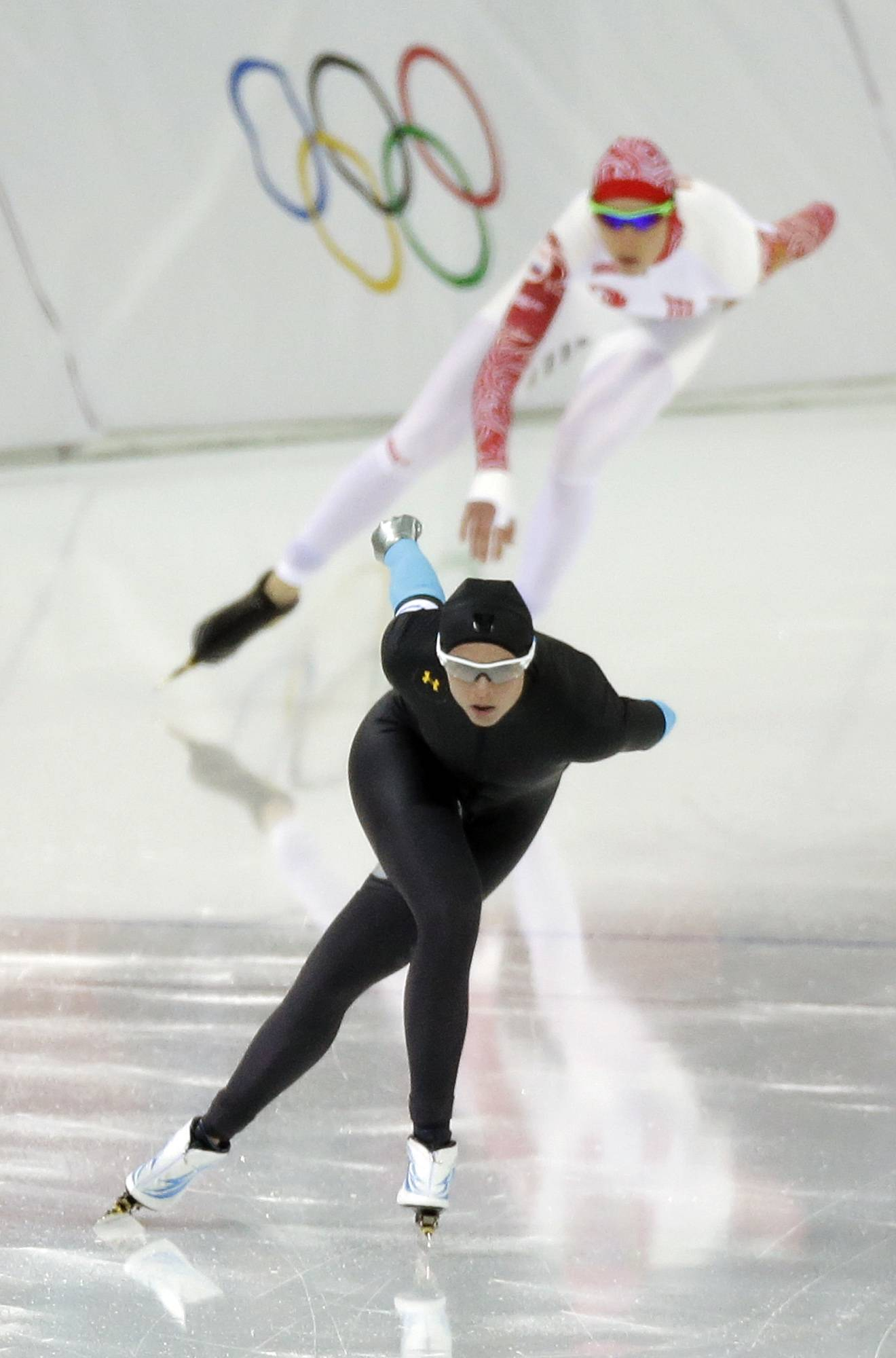 Brittany Bowe of the U.S., front and Russia's Yekaterina Lobysheva compete in the women's 1,500-meter race at the Adler Arena Skating Center during the 2014 Winter Olympics in Sochi, Russia, Sunday, Feb. 16, 2014.