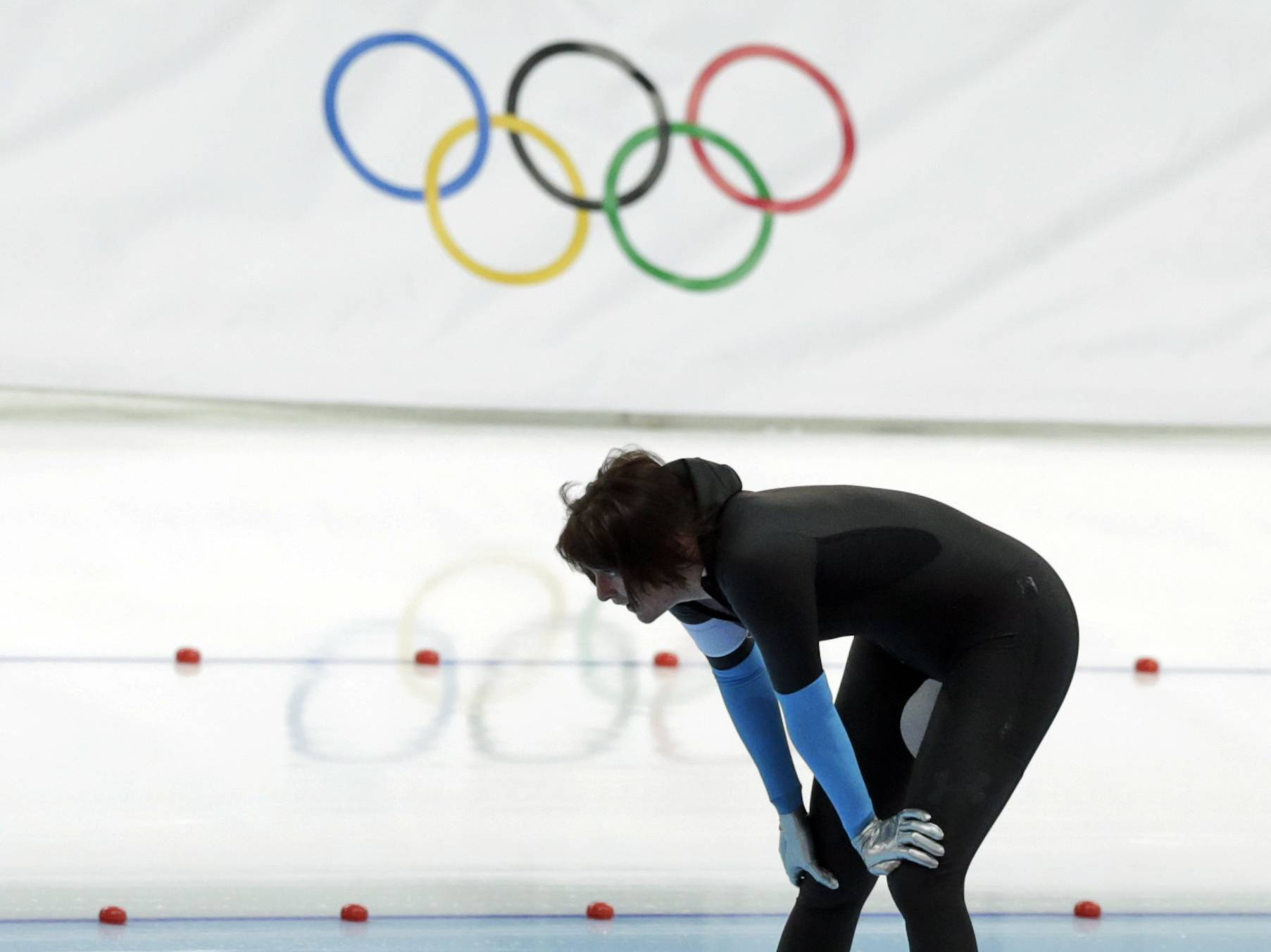 Heather Richardson of the U.S. catches her breath after competing in the women's 1,500-meter race at the Adler Arena Skating Center during the 2014 Winter Olympics in Sochi, Russia, Sunday, Feb. 16, 2014.