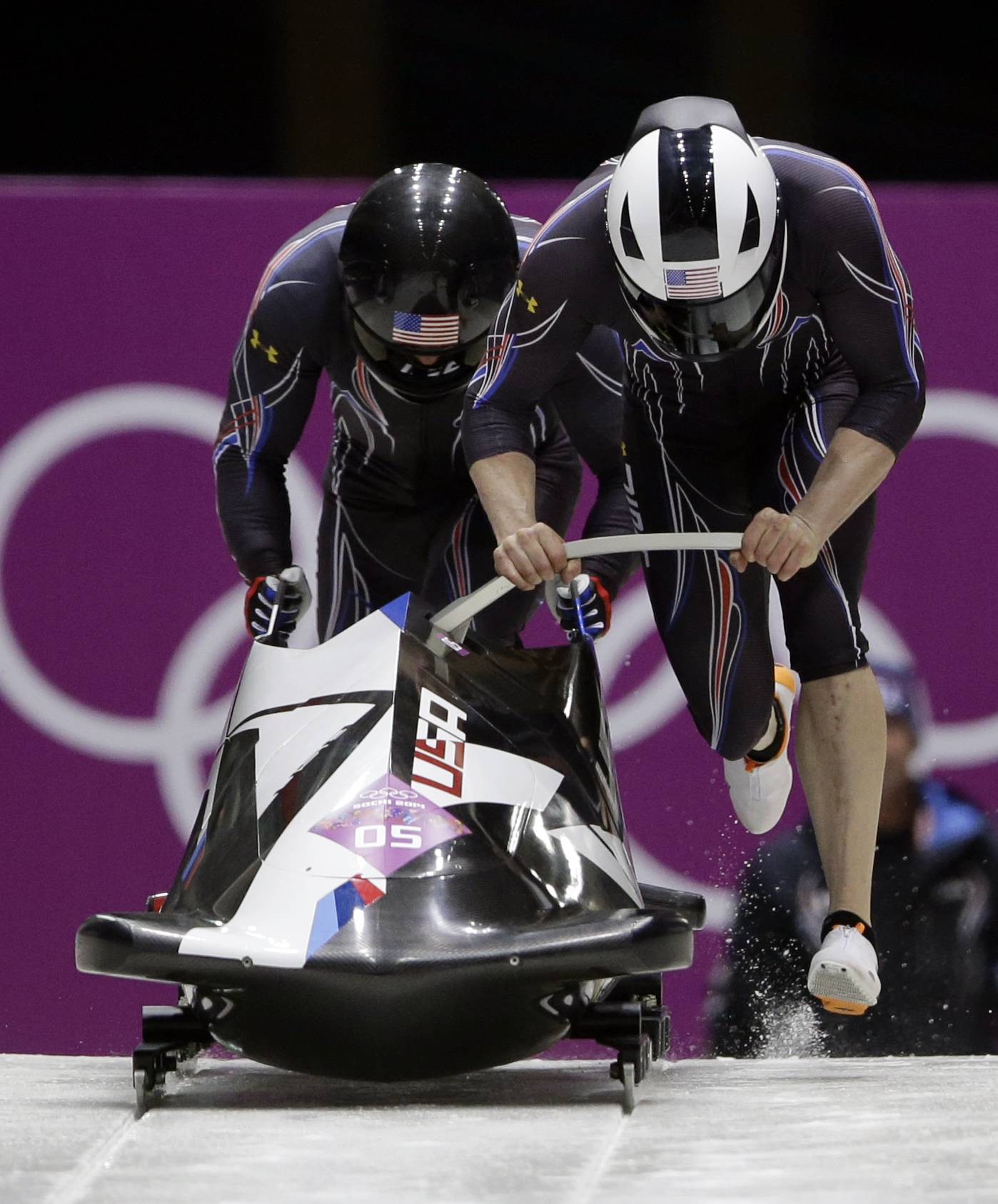 The team from the United States USA-2, piloted by Cory Butner and brakeman Christopher Fogt, start their first run during the men's two-man bobsled competition at the 2014 Winter Olympics, Sunday, Feb. 16, 2014, in Krasnaya Polyana, Russia.
