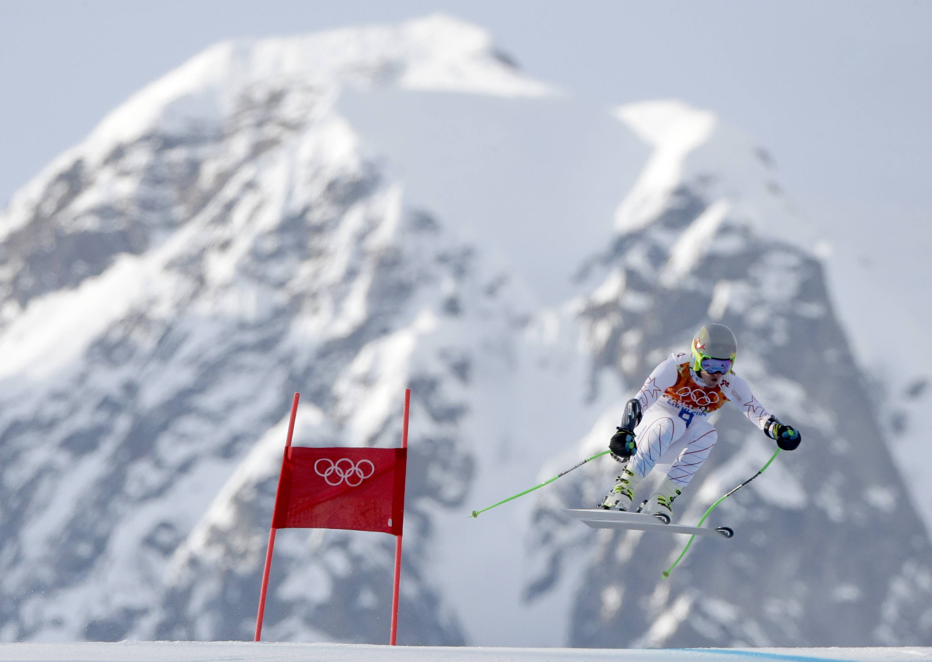 United States' Ted Ligety makes a jump in the men's super-G at the Sochi 2014 Winter Olympics, Sunday, Feb. 16, 2014, in Krasnaya Polyana, Russia.