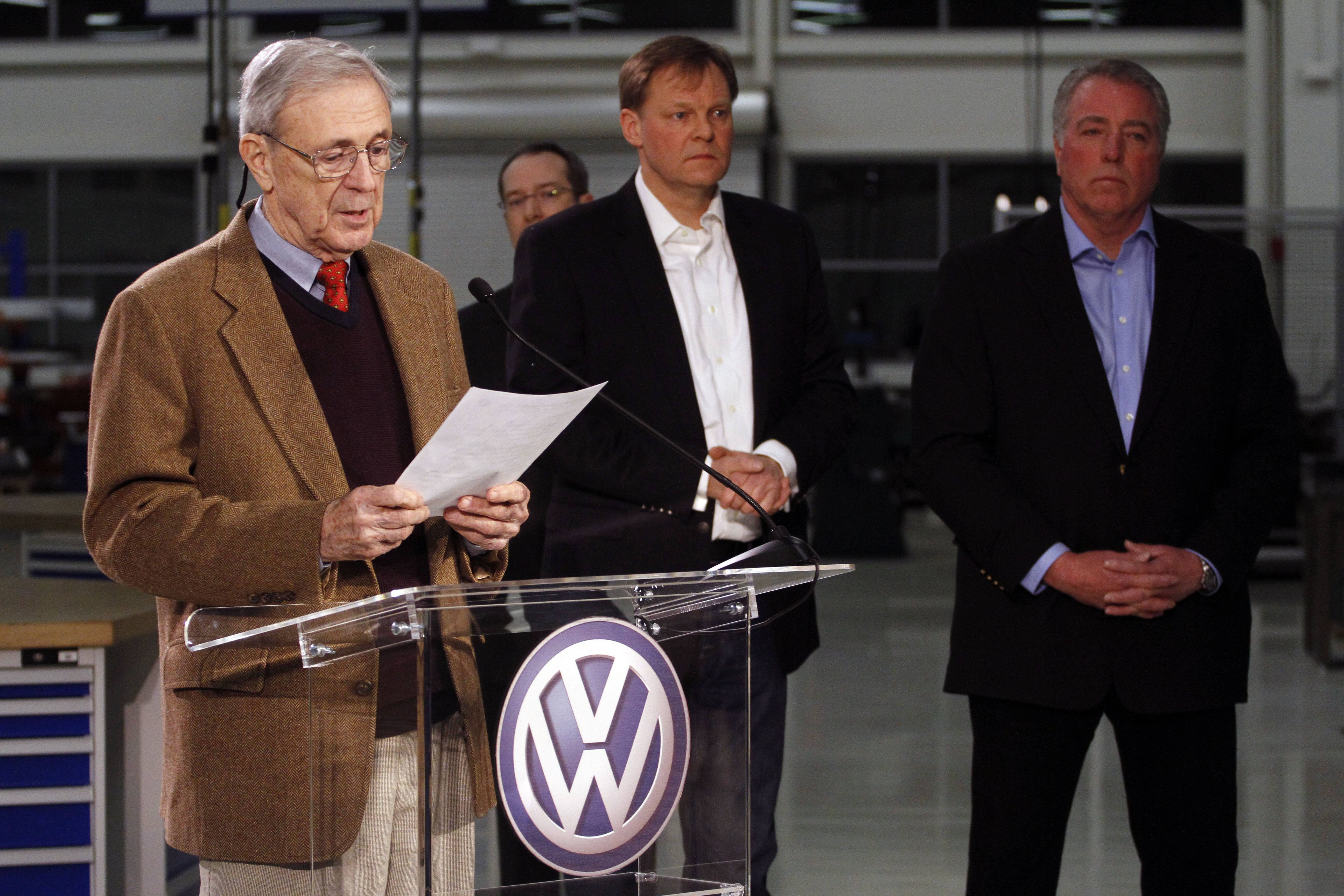 Retired circuit judge Sam Payne, left, announces Friday that Volkswagen employees voted to deny representation by the United Auto Workers union as Frank Fischer, Chairman and CEO of the Volkswagen Group of America, center, and Gary Casteel, UAW Region 8 Director, look on from behind in Chattanooga, Tenn. The multiyear effort to organize Volkswagen's only U.S. plant was defeated on a 712-626 vote Friday night amid heavy campaigning on both sides. Mike Jarvis, who was among the group of workers in the plant that organized to fight the UAW, said his colleagues were unwilling to risk hurting the plant.