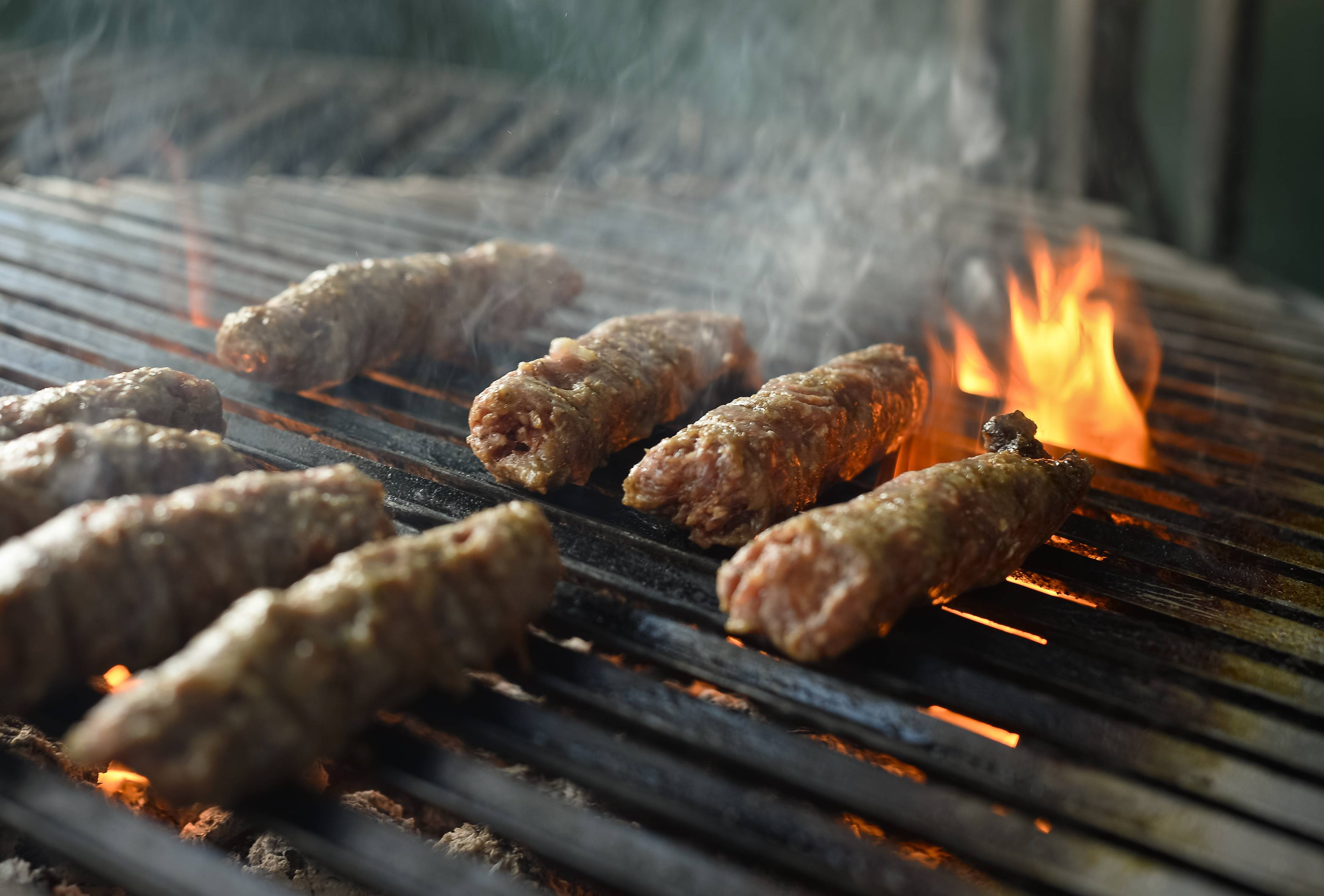 """Mici,"" the Romanian version of a Turkish dish, spicy grilled sausages, popular across the Balkans, are grilled in a restaurant in Bucharest, Romania. Officials in Brussels have agreed that spicy ""mici"", grilled meat bullet shaped delicacies which rely on a pinch of bicarbonate of soda for their distinctive succulent flavor and puffy texture will be permitted under European Union rules, the Romanian Meat Association says."