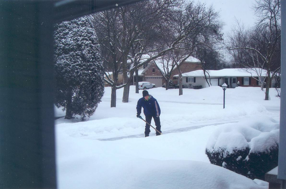 Kevin Kearns of Arlington Heights, shoveling Betty Hopkins' walk.