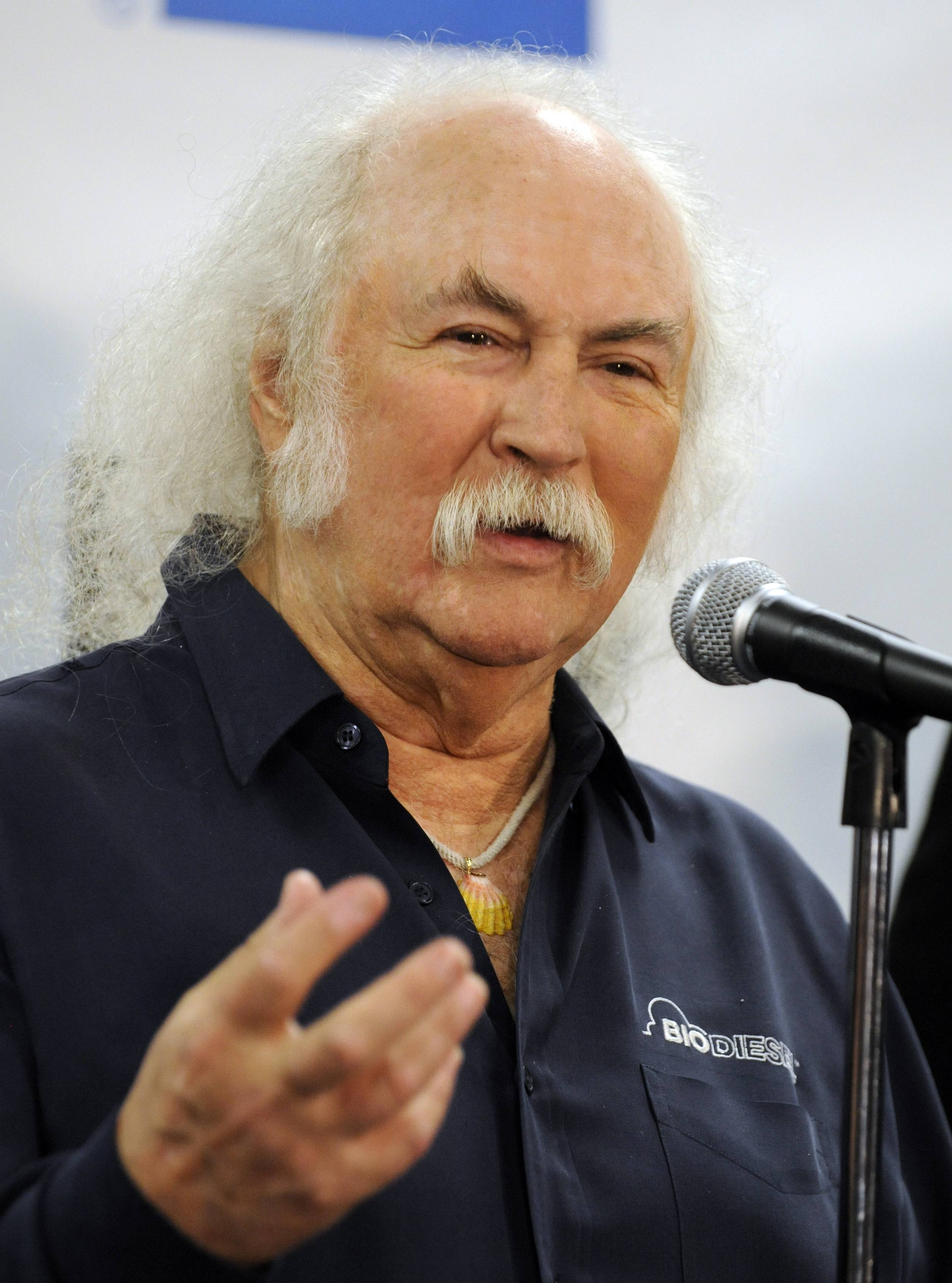 This Oct. 29, 2009 file photo shows, David Crosby in the press room at the 25th Anniversary Rock & Roll Hall of Fame concert at Madison Square Garden in New York. Crosby has undergone heart surgery and he's postponing sold-out California shows. Publicist Michael Jensen tells City News Service on Monday that the 72-year-old Crosby had a cardiac catheterization last week to fix a blocked coronary artery.