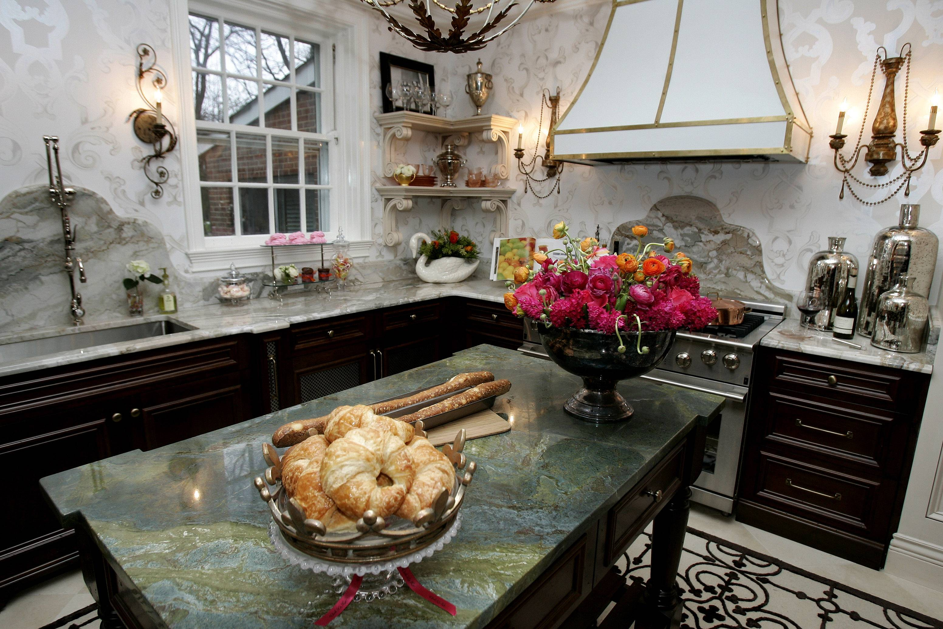 Big islands need big things on them, such as large bowls or trays, says Sara Peterson, editor-in-chief of HGTV Magazine.