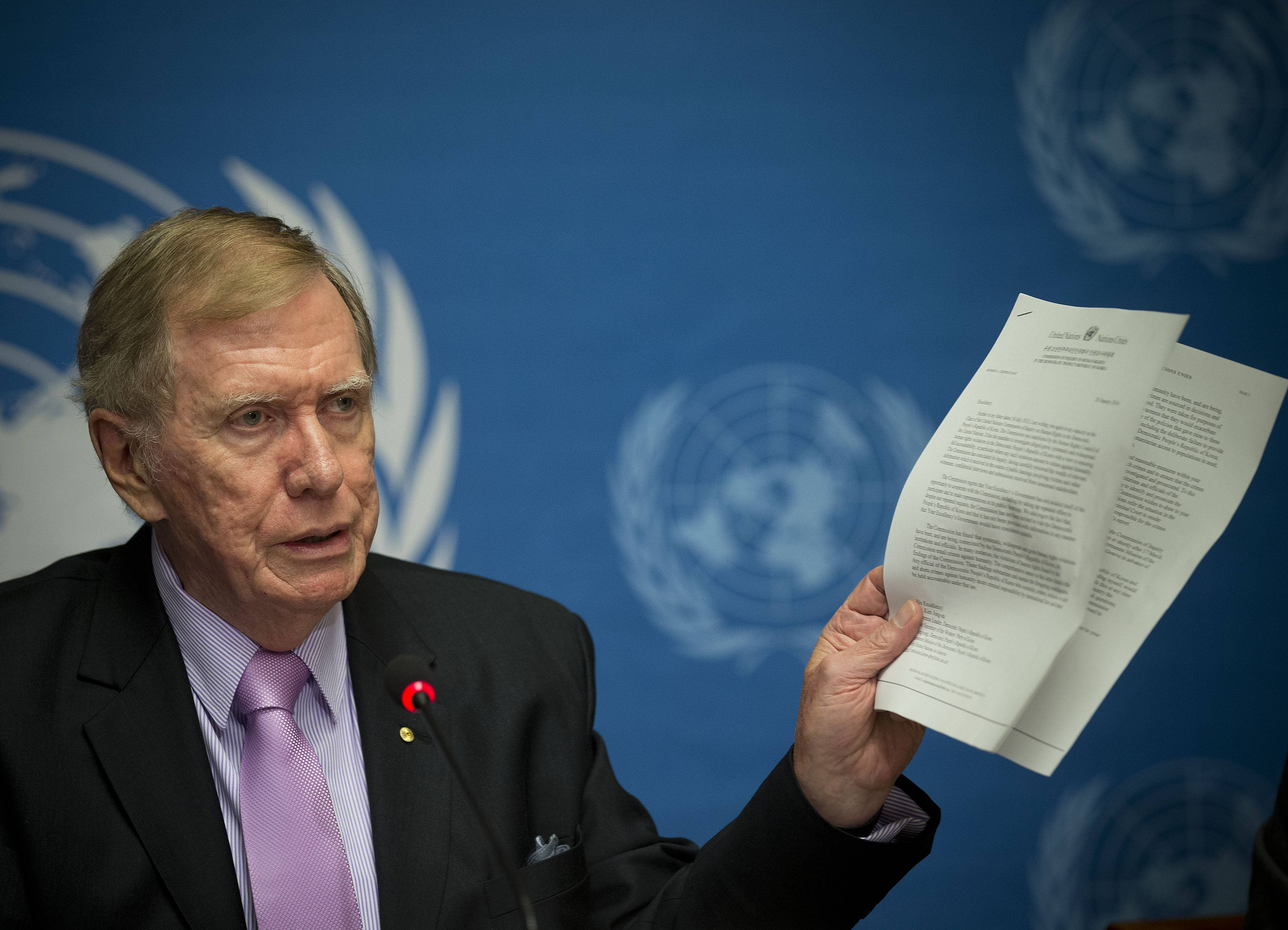 "Retired Australian judge Michael Kirby, chairman of the commission of Inquiry on Human Rights in the Democratic People's Republic of Korea, shows a UN letter to North Korean leader warning on-accountability for 'crimes' Monday during a news conference at the United Nations in Geneva, Switzerland. A U.N. panel has warned North Korean leader Kim Jong Un that he may be held accountable for orchestrating widespread crimes against civilians in the secretive Asian nation. Kirby told the leader in a letter accompanying a yearlong investigative report on North Korea that international prosecution is needed ""to render accountable all those, including possibly yourself, who may be responsible for crimes against humanity."""