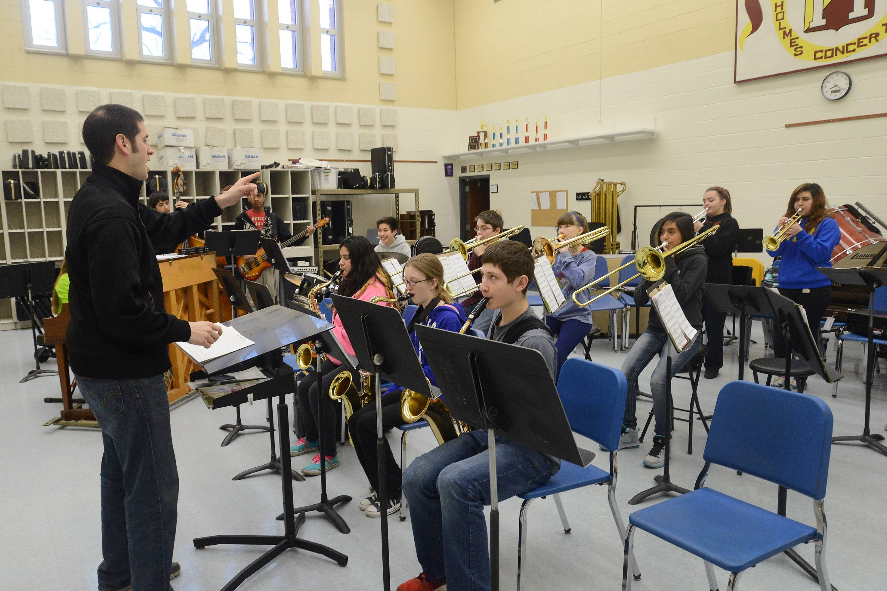 Jazz director Bryan Itzkowitz rehearses the Holmes Middle School jazz band in Wheeling in preparation for the upcoming Jazz in the Meadows competition.