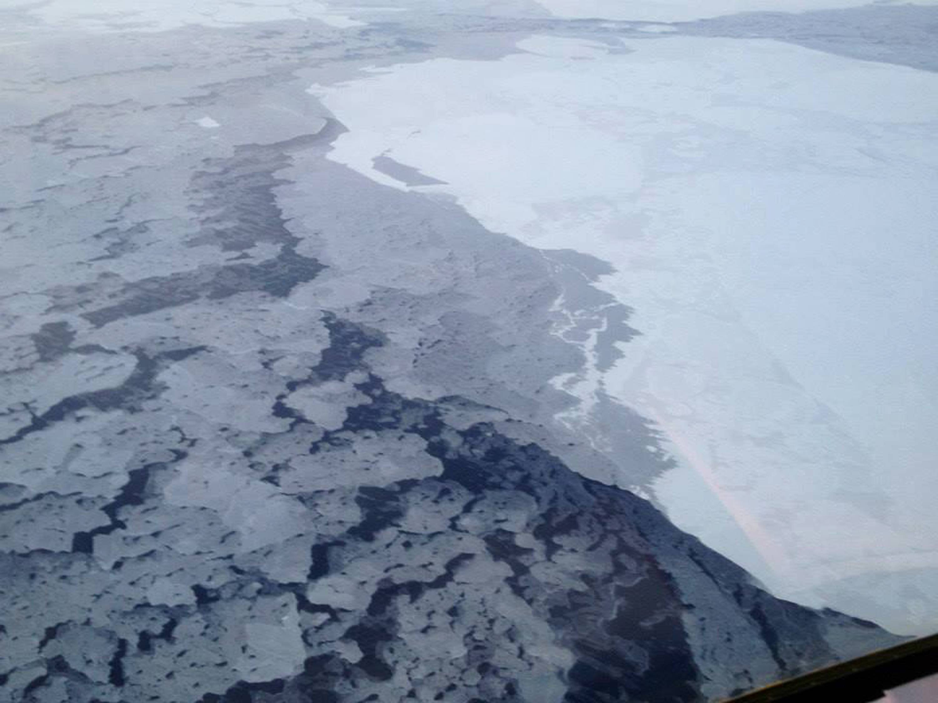 This handout photo provided by The National Oceanic and Atmospheric Administration (NOAA) shows Arctic sea ice in 2013. The Arctic isn't nearly as bright and white as it used to be because of more ice melting in the ocean, and that's turning out to be a global problem, a new study says. With more dark, open water in the summer, less of the sun's heat is reflected back into space. So the entire Earth is absorbing more heat than expected, according to a study published Monday in the Proceedings of the National Academy of Sciences.