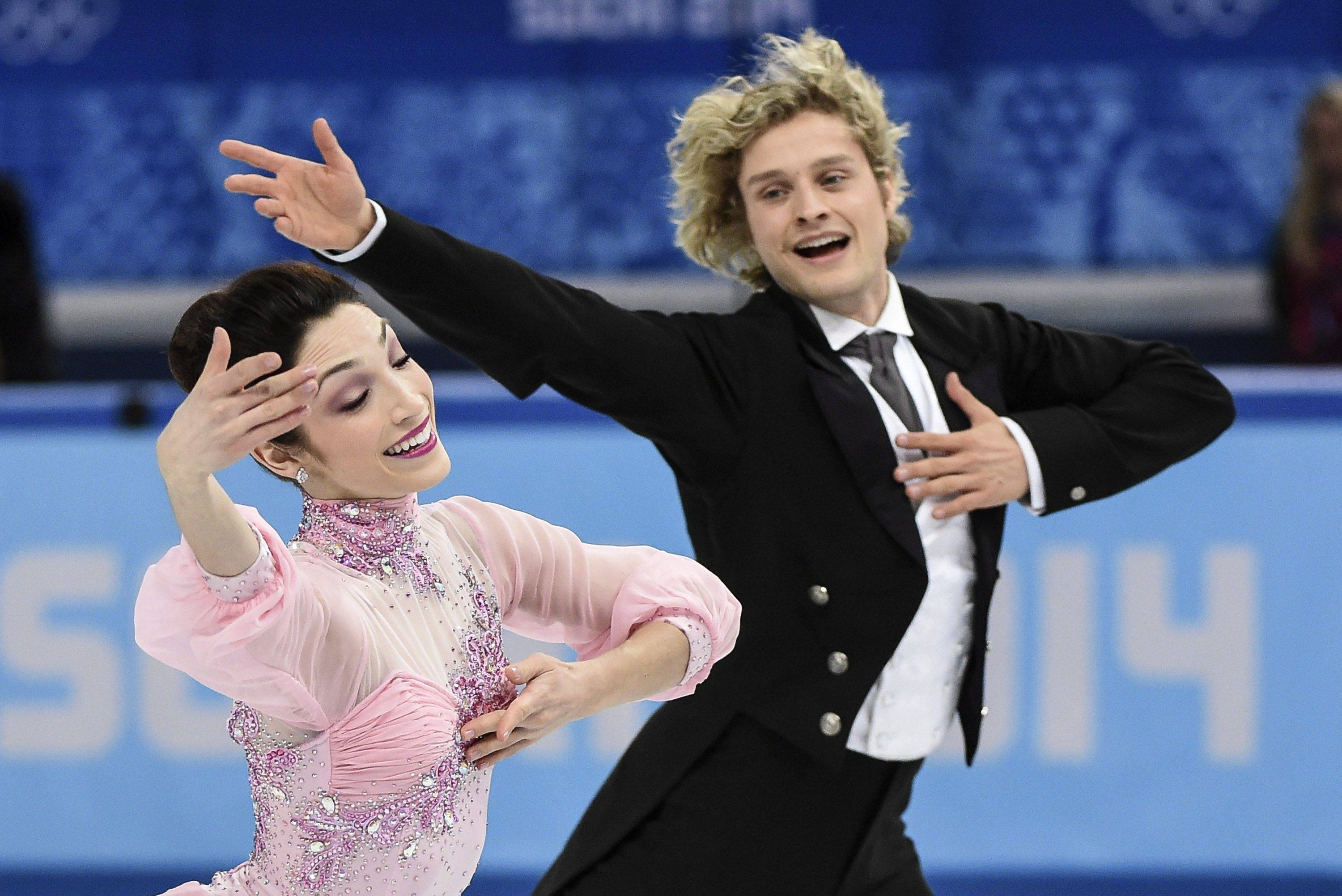 Meryl Davis and Charlie White, of the United States, compete in the ice dance short dance figure skating competition Sunday at the Iceberg Skating Palace during the Winter Olympics in Sochi, Russia. The pair will compete this morning to be the first ice dancers from the US to take home the gold.