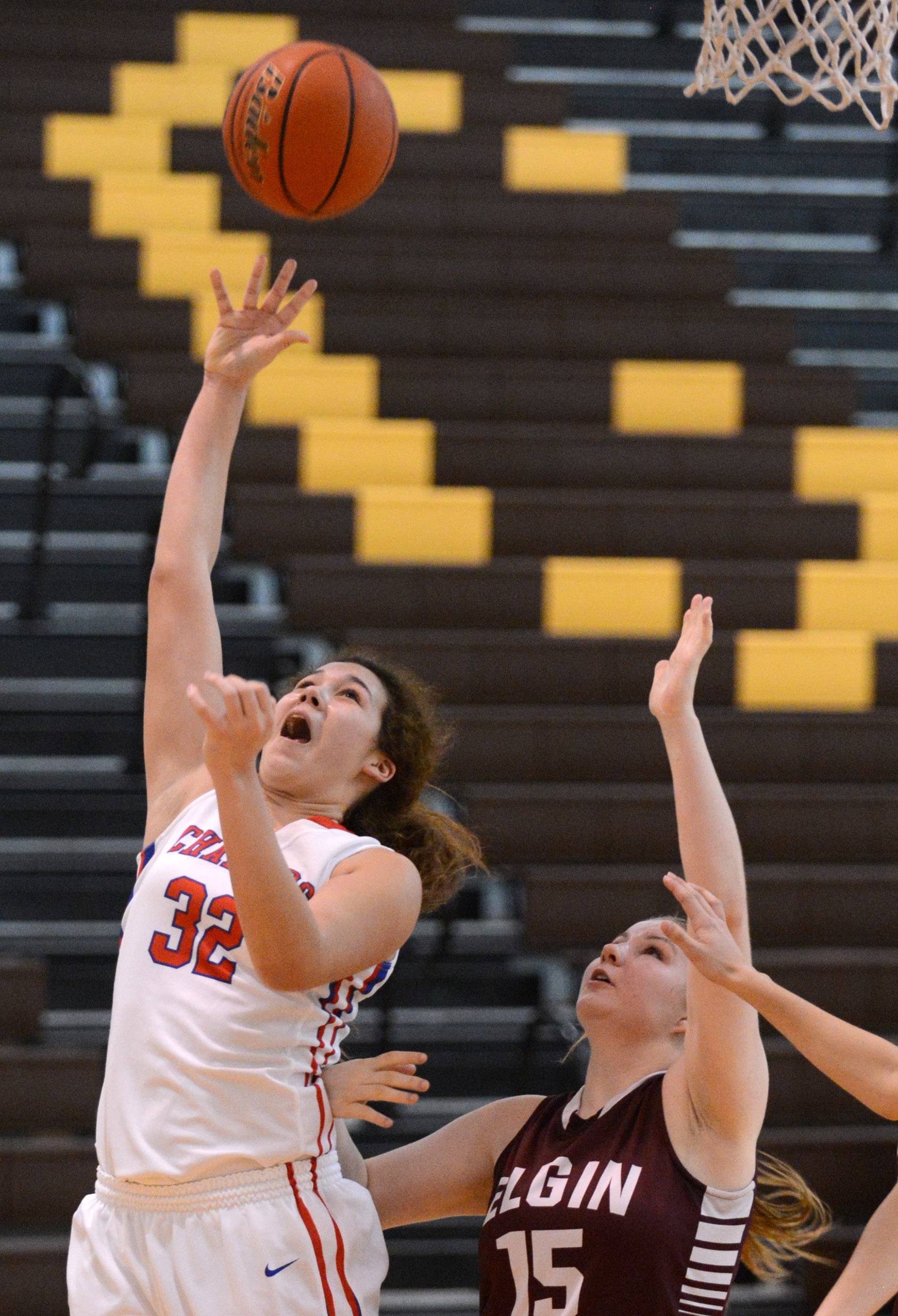 Dundee-Crown's Jesania Laboy (32) shoots and scores against Elgin during Monday's regional action in Algonquin.