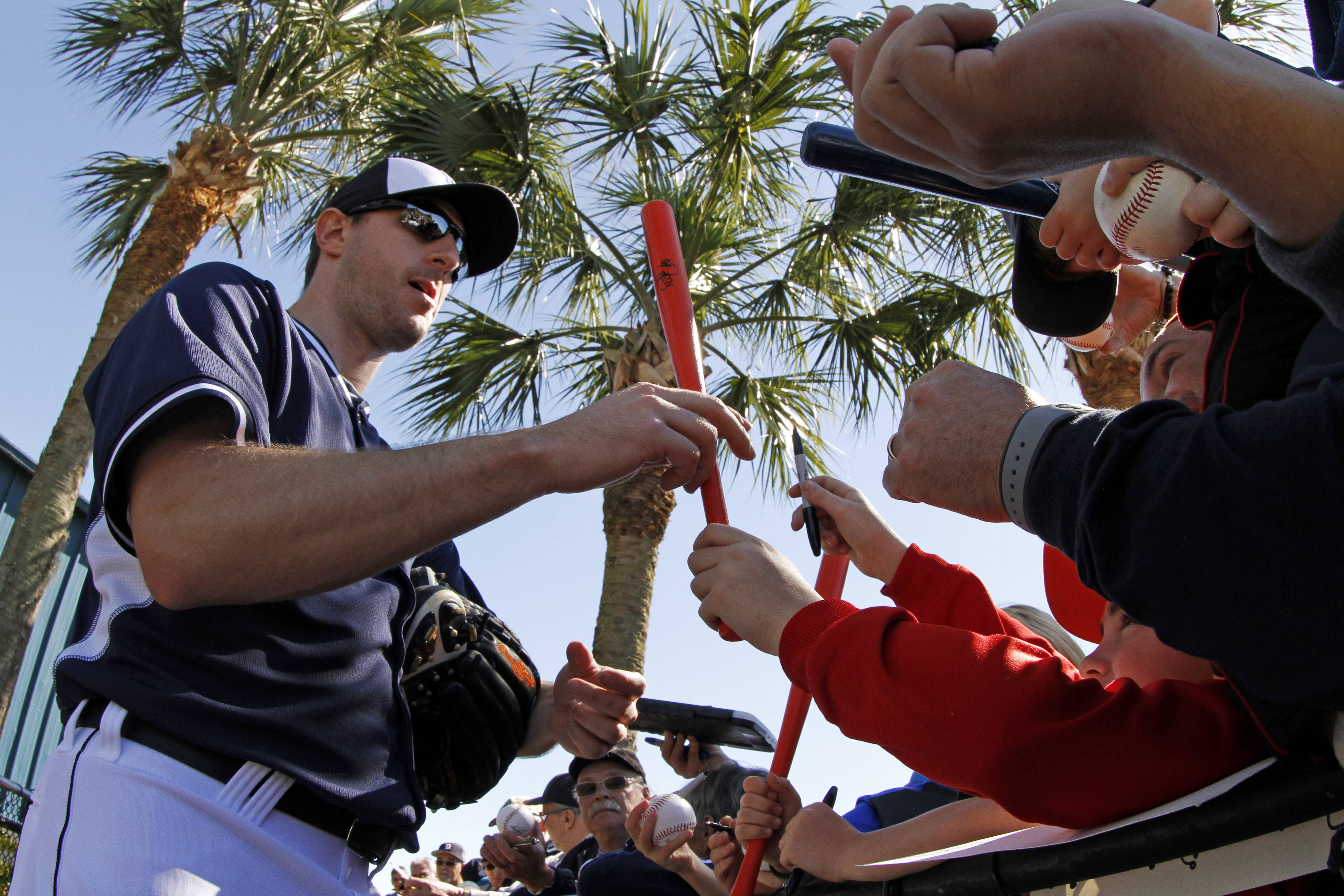 Detroit Tigers pitcher Max Scherzer signs autographs for fans Friday after the Tigers' first day of spring training for pitchers and catchers in Lakeland, Fla.