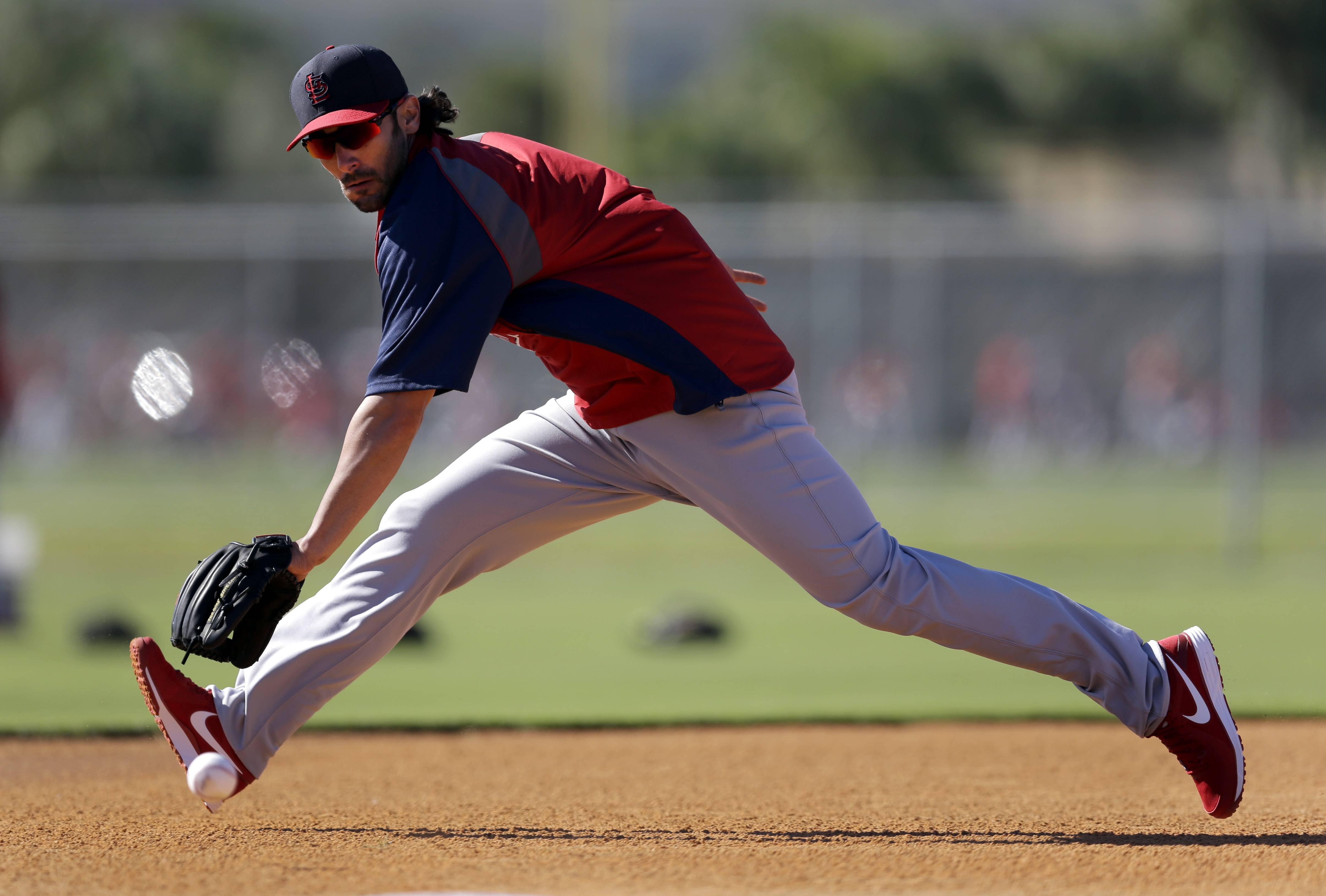 St. Louis Cardinals infielder Matt Carpenter handles a grounder during spring training practice Sunday in Jupiter, Fla.