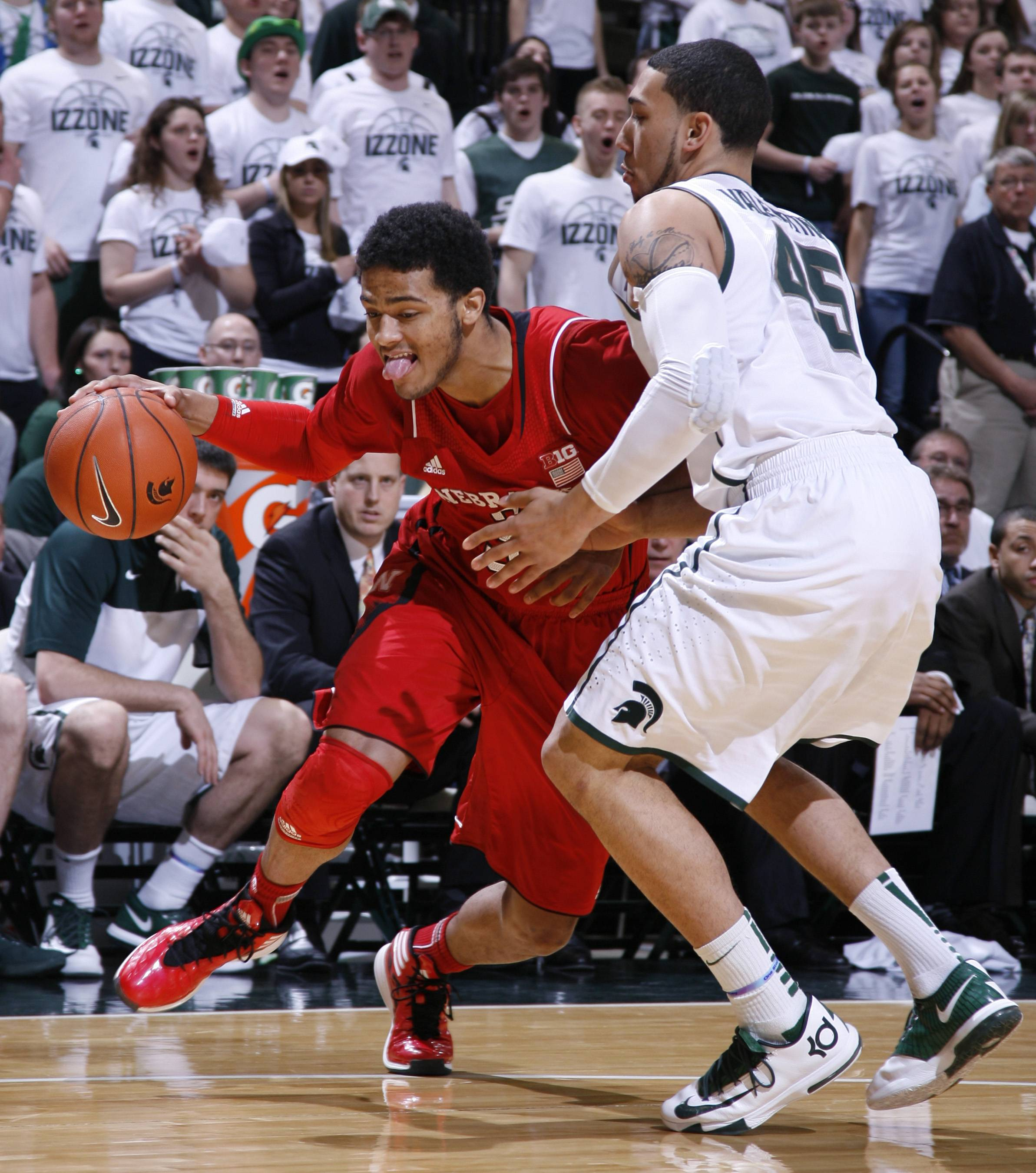 Nebraska's Benny Parker drives against Michigan State's Denzel Valentine during the first half of Sunda's game in East Lansing, Mich. Nebraska won 60-51.
