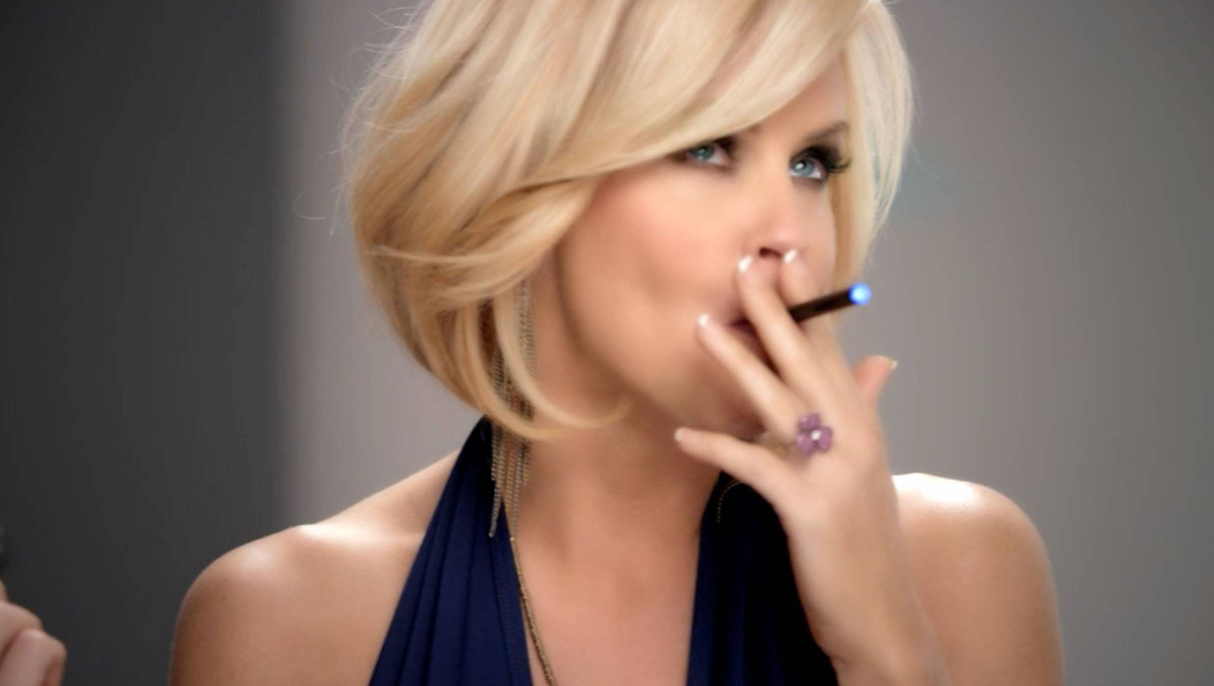 In this undated image, Jenny McCarthy uses a blu eCig in a television advertisement. Some experts believe that at a time when cigarette smoking has finally become passe in popular culture, e-cigarettes may re-glamorize puffing away in public places.