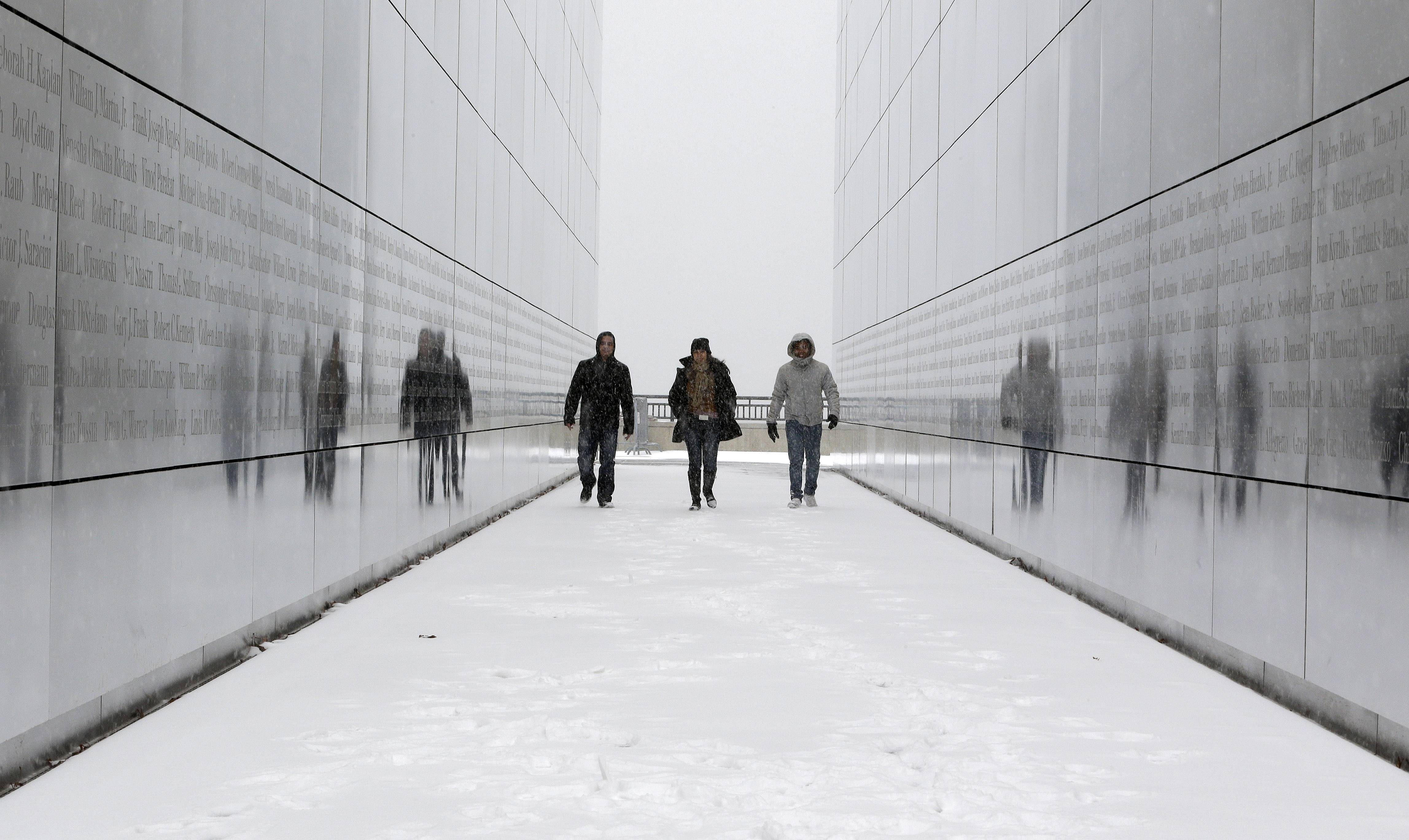 Tourists walk through the snow-covered Empty Sky Memorial at Liberty State Park in Jersey City, N.J. in January. Researchers who analyzed local climate trends and hospital records on millions of Americans say there may be a link between weather and the risk for stroke. Cold weather, high humidity and big daily temperature swings brought more stroke hospitalizations.
