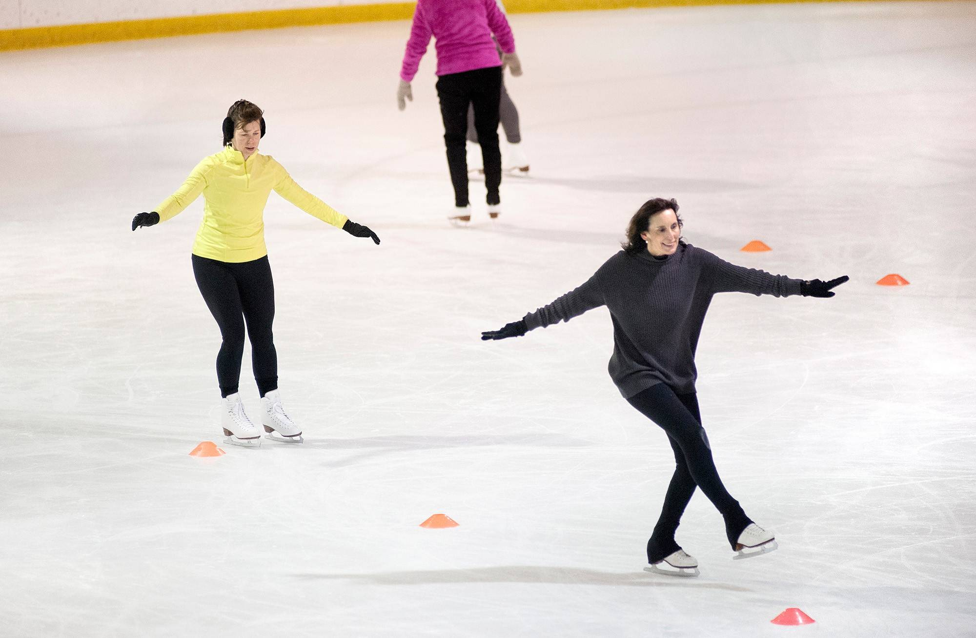 Jeanne Erdmann, right, participates in an ice skating aerobics class at the Hardeeís Iceplex in Chesterfield, Mo.
