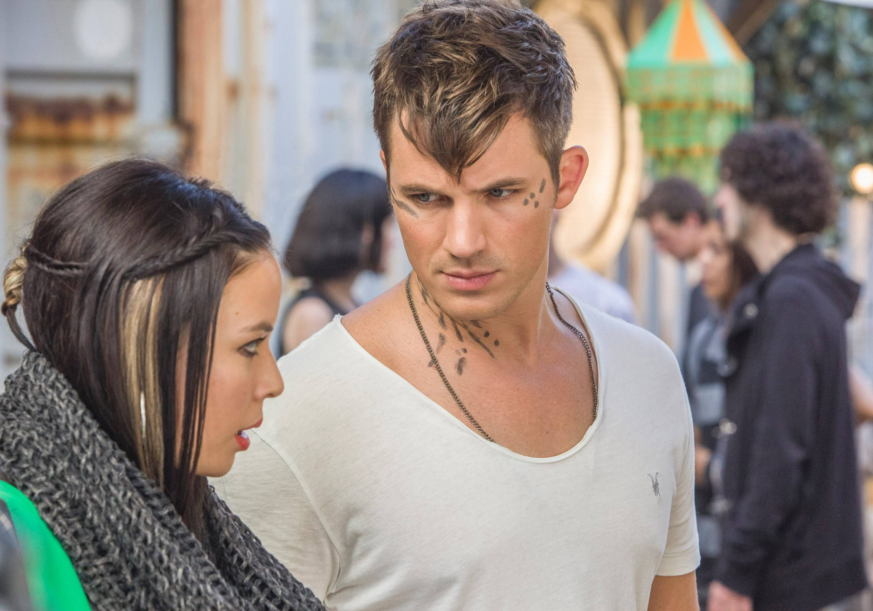 "Roman (Matt Lanter) and Julie (Malese Jow) have to figure out how to fit in with humans in The CW's ""Star-Crossed."""