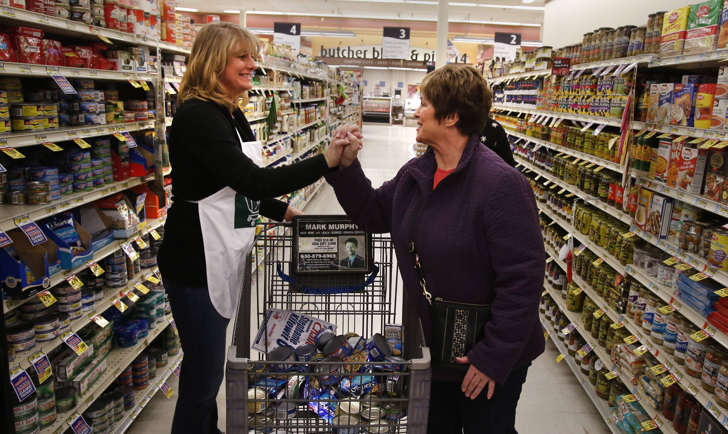 State Rep. Stephanie Kifowit, left, congratulates her shopping assistant, Bonnie Wegman of the Marie Wilkinson Food Pantry, after Kifowit's shopping spree time expired Monday at the Jewel-Osco in Batavia.