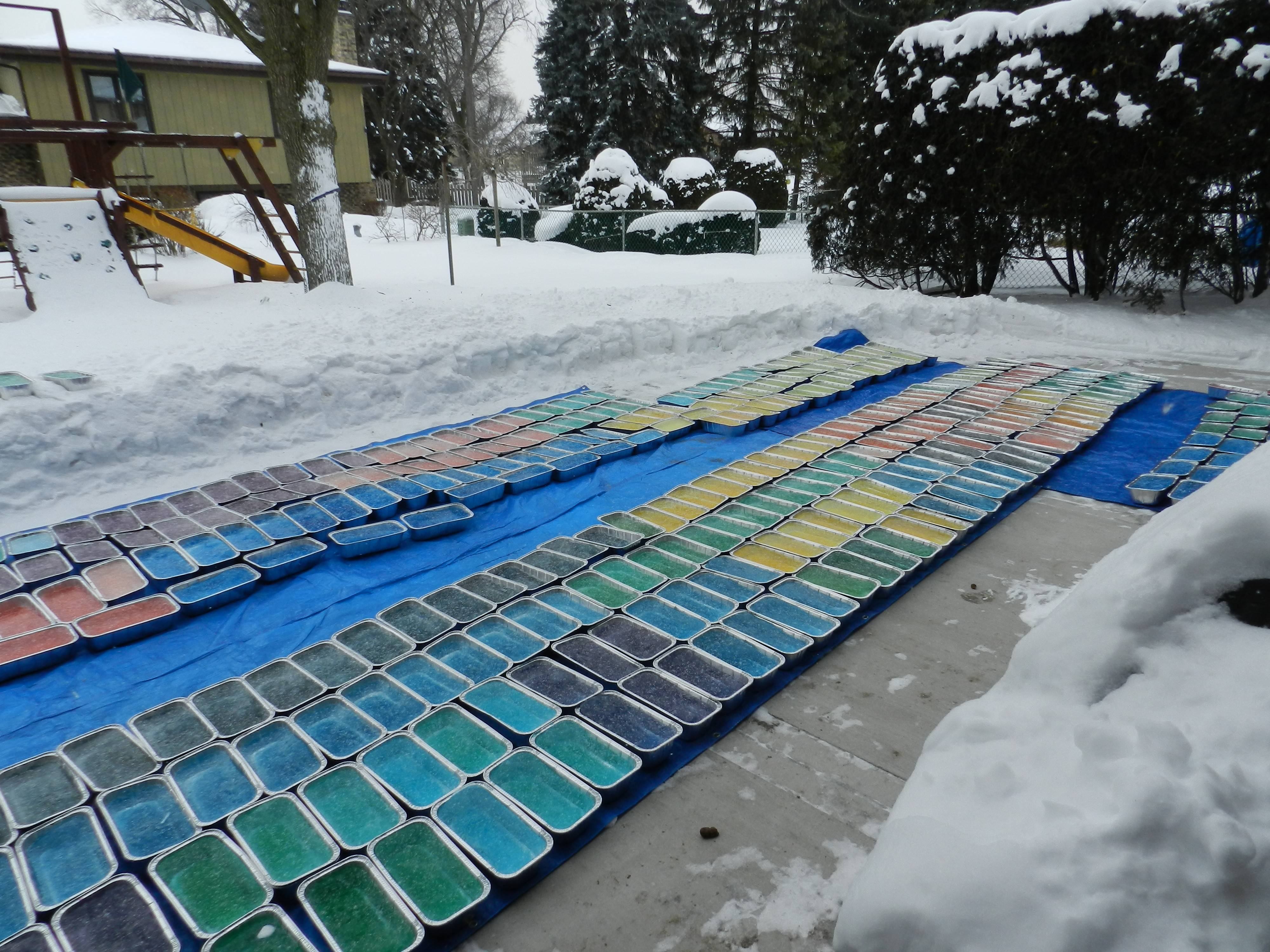 Bridgett and Meggan Grahn froze 600 six-pound bricks of ice on their mother's patio to build an igloo in the front yard.