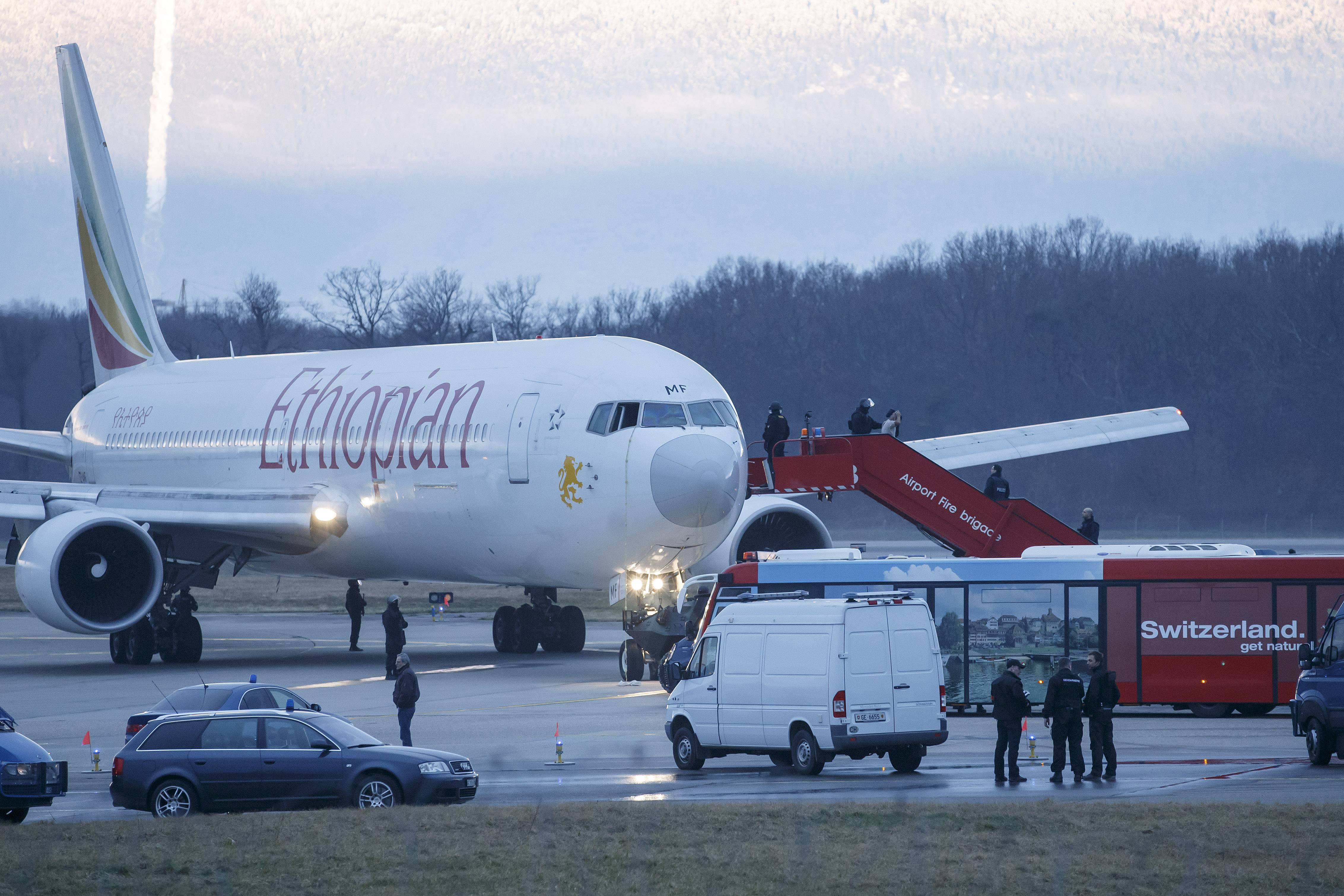 Passengers are evacuated Monday from a hijacked Ethiopian Airlines Plane on the airport in Geneva, Switzerland. A hijacked aircraft traveling from Addis Abeda, Ethiopia, to Rome has landed at Geneva's international airport early Monday morning. Swiss authorities have arrested the hijacker.