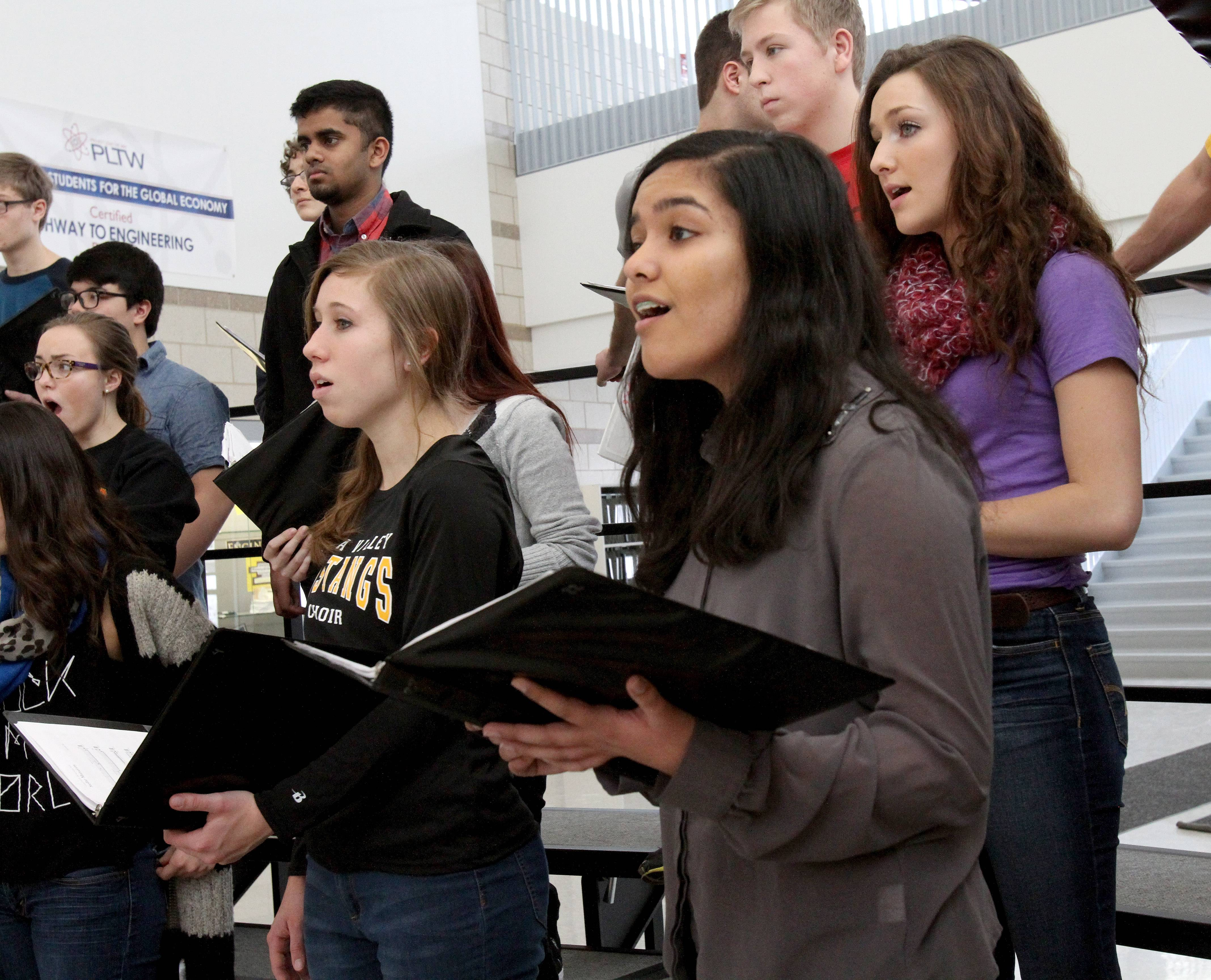 "Sushmitha Suresh, a sophomore at Metea Valley High School in Aurora, practices with the chamber singers, one of several vocal groups at the school to which she belongs. Sushmitha, 15, got to sing part of ""America the Beautiful"" in Hindi for a Coca-Cola commercial shown during the second quarter of the Super Bowl."