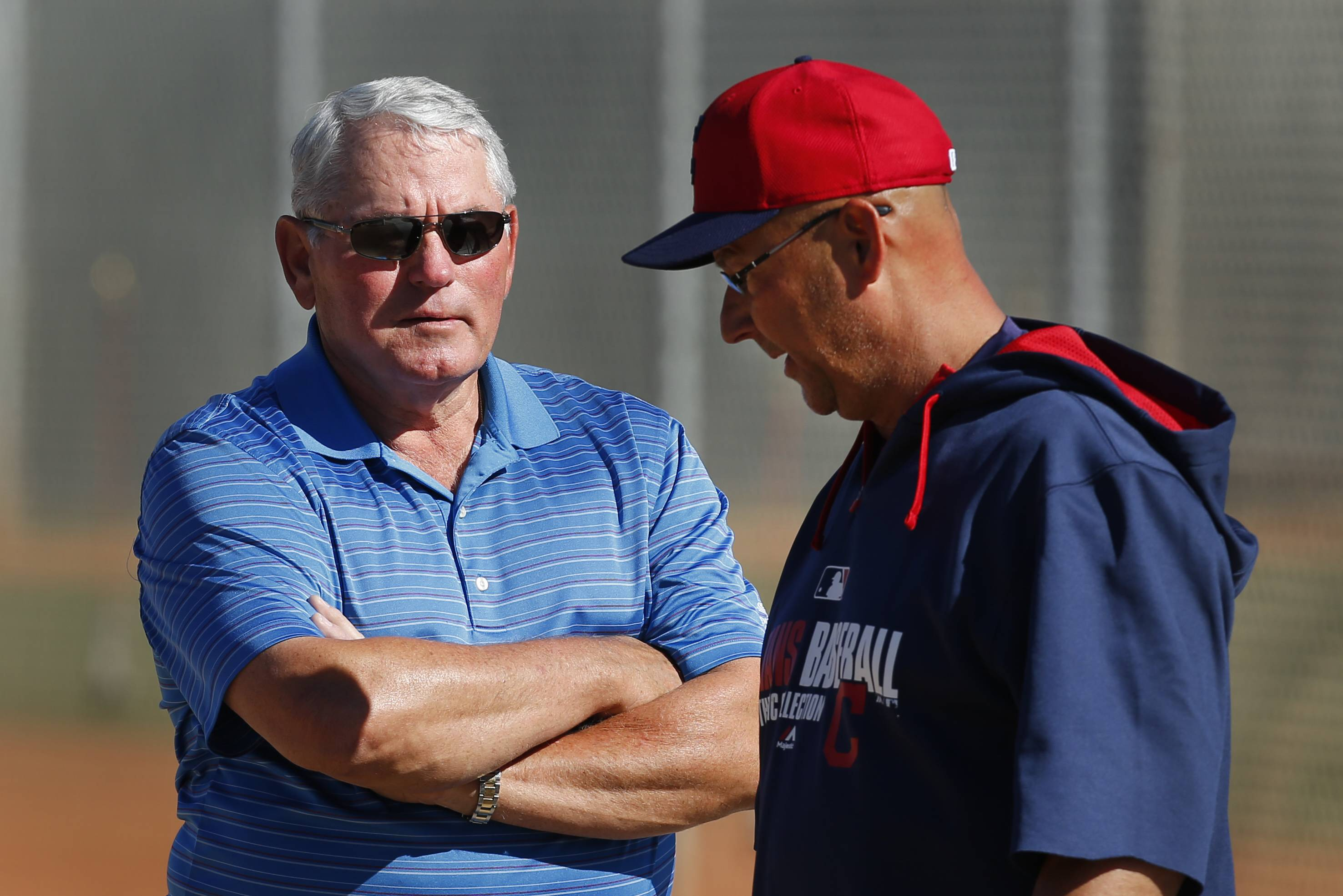 Former Cleveland Indians manager Mike Hargrove, left, talks with current manager Terry Francona during spring training practice Monday in Goodyear, Ariz.