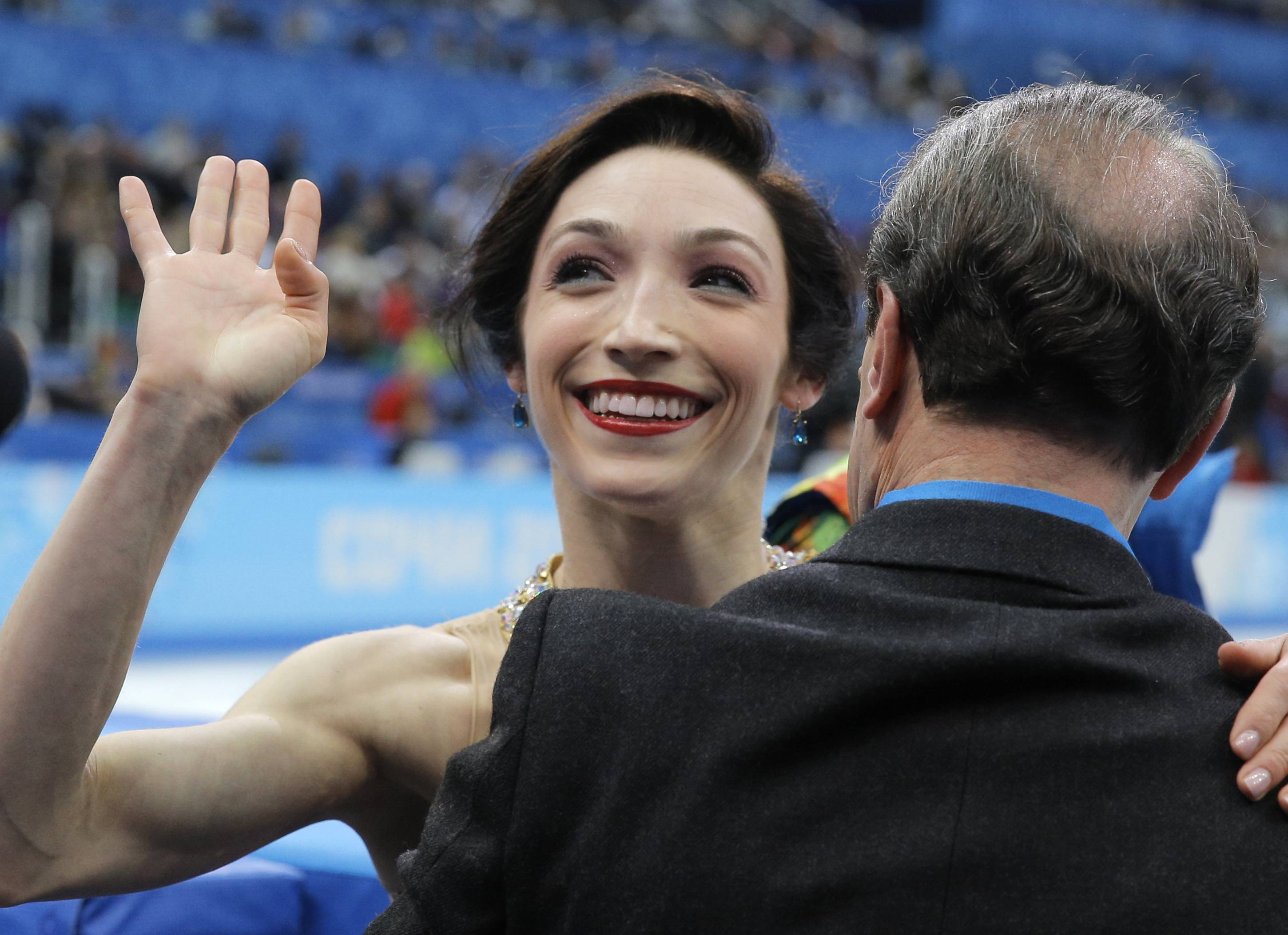 Meryl Davis waves to spectators after she and Charlie White of the United States competed Monday in the ice dance free dance figure skating finals at the Iceberg Skating Palace during the 2014 Winter Olympics in Sochi, Russia.