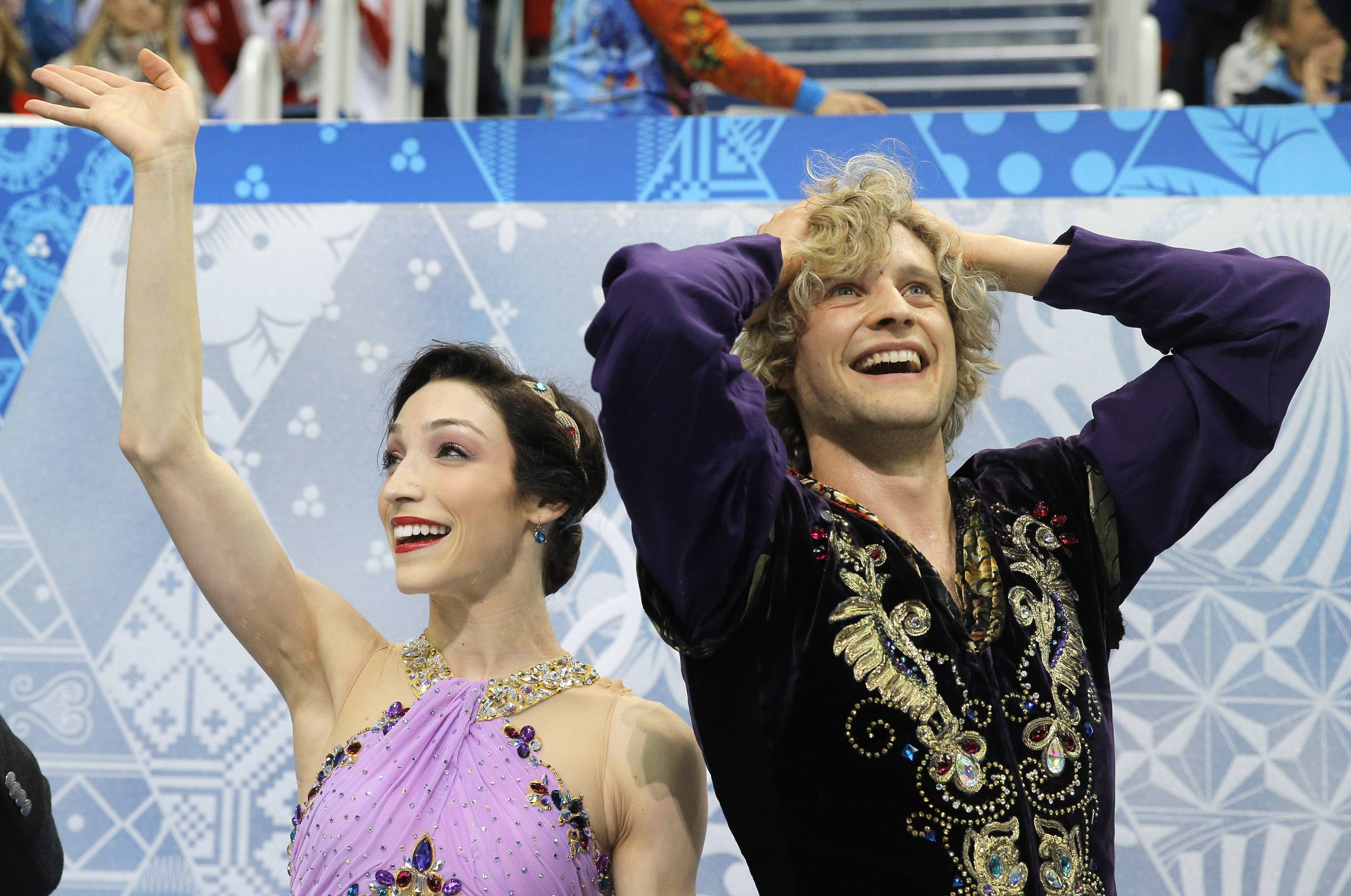 Meryl Davis and Charlie White of the United States react in the results area Monday after competing in the ice dance free dance figure skating finals at the Iceberg Skating Palace during the 2014 Winter Olympics in Sochi, Russia.