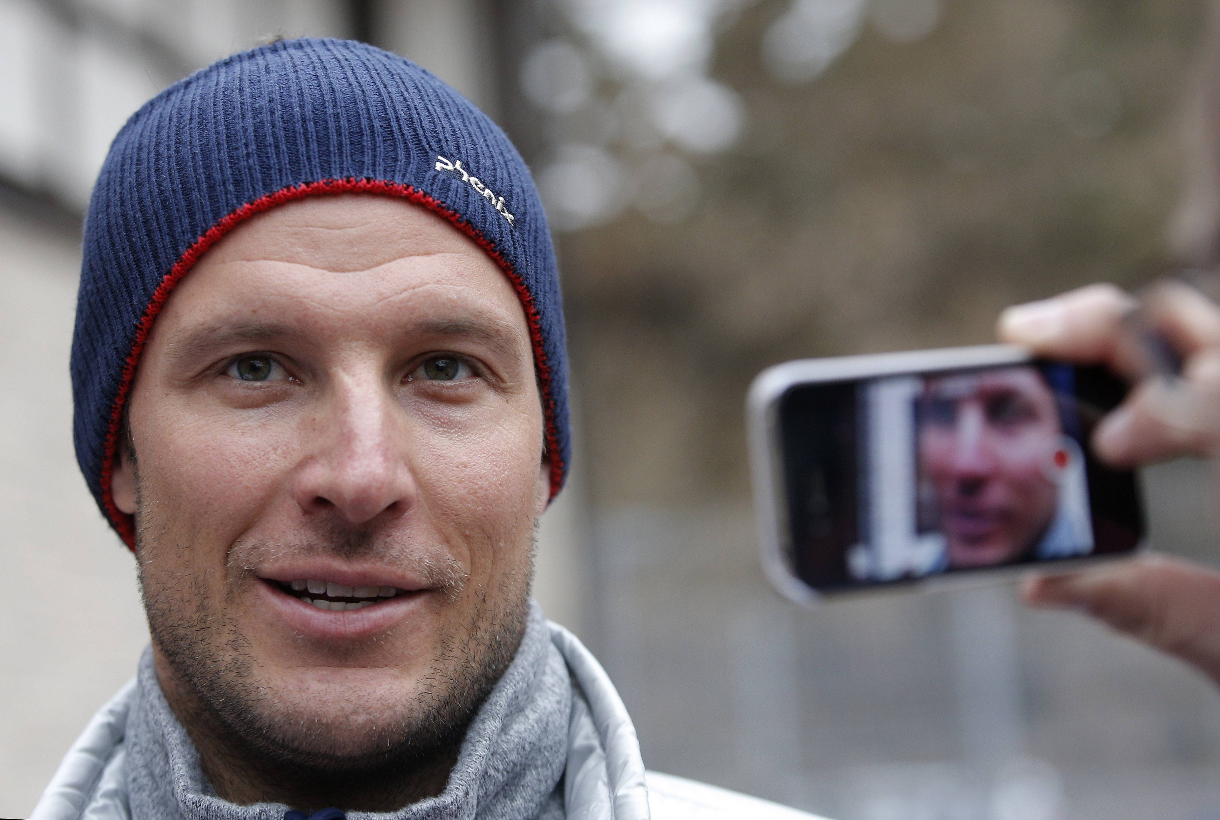 Norway's Aksel Lund Svindal addresses members of the media Monday at the Sochi 2014 Winter Olympics in Krasnaya Polyana, Russia. Svindal is leaving the Olympics because he has problems with allergies and fatigue, the Norwegian men's Alpine skiing coach said Monday.