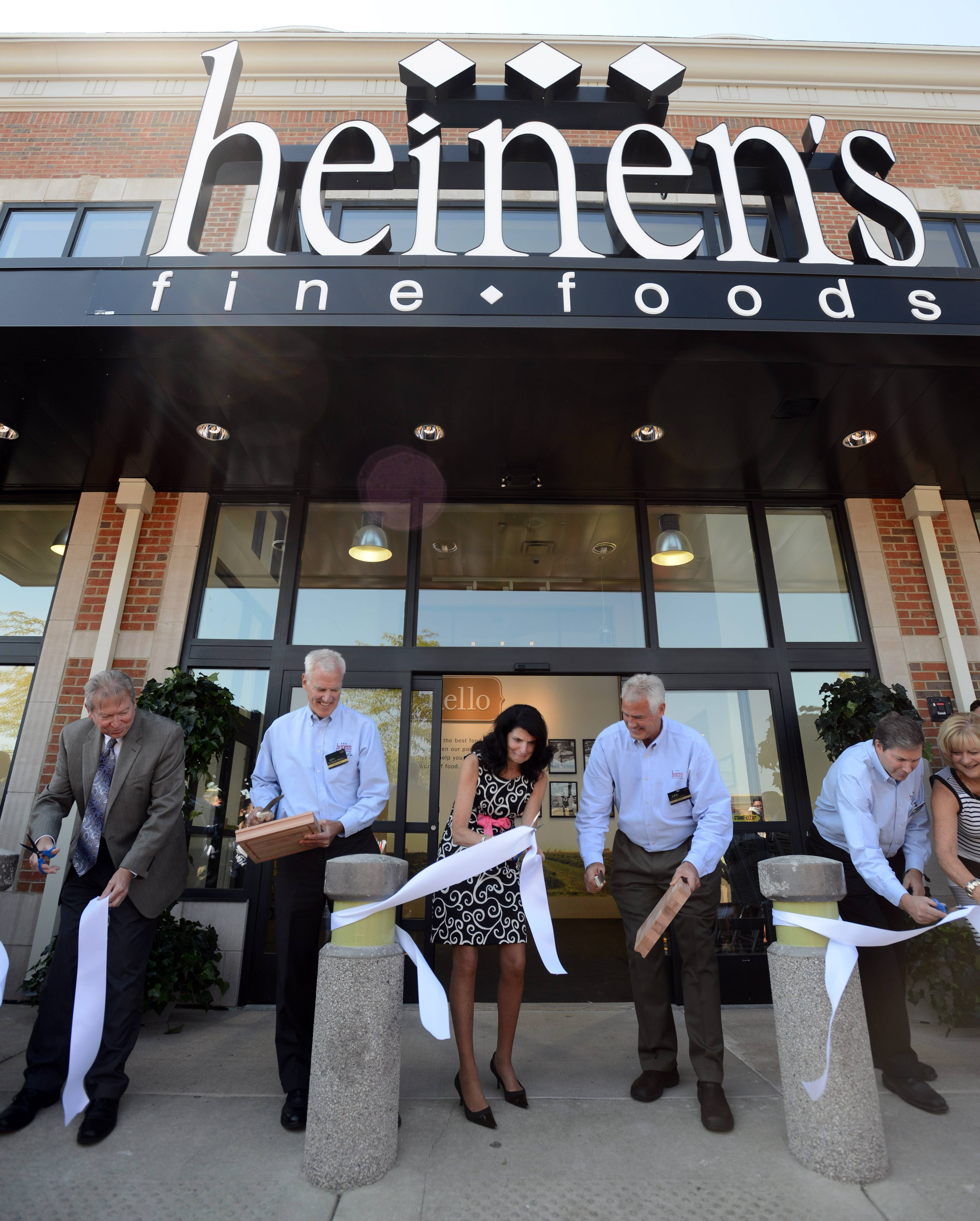 Brothers Jeff and Tom Heinen and Barrington Mayor Karen Darch cut the ribbon at the grand opening of Heinen's Fine Foods in Barrington in 2012.