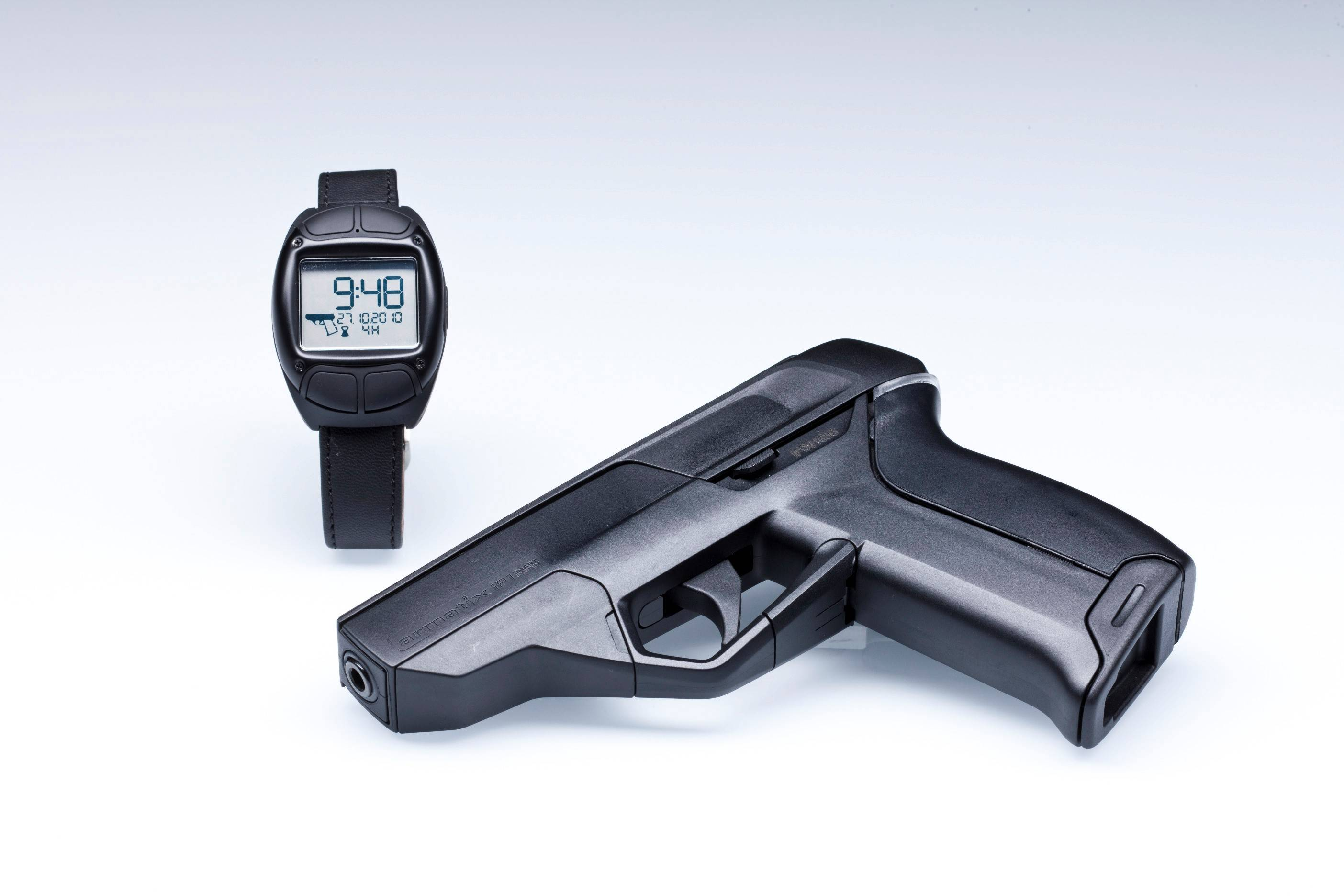 The Armatix iP1 pistol and the iW1 active RFID watch are shown in this photo provided by the manufacturer. The Armatix Smart System consists of a radio-controlled watch that is responsible for gun access and use. A Smart System gun will only shoot if it is within range of the watch. Illustrates GUNS (category a), by Michael S. Rosenwald (c) 2014, The Washington Post. Moved Tuesday, Feb. 18, 2014. (MUST CREDIT: Armatix)
