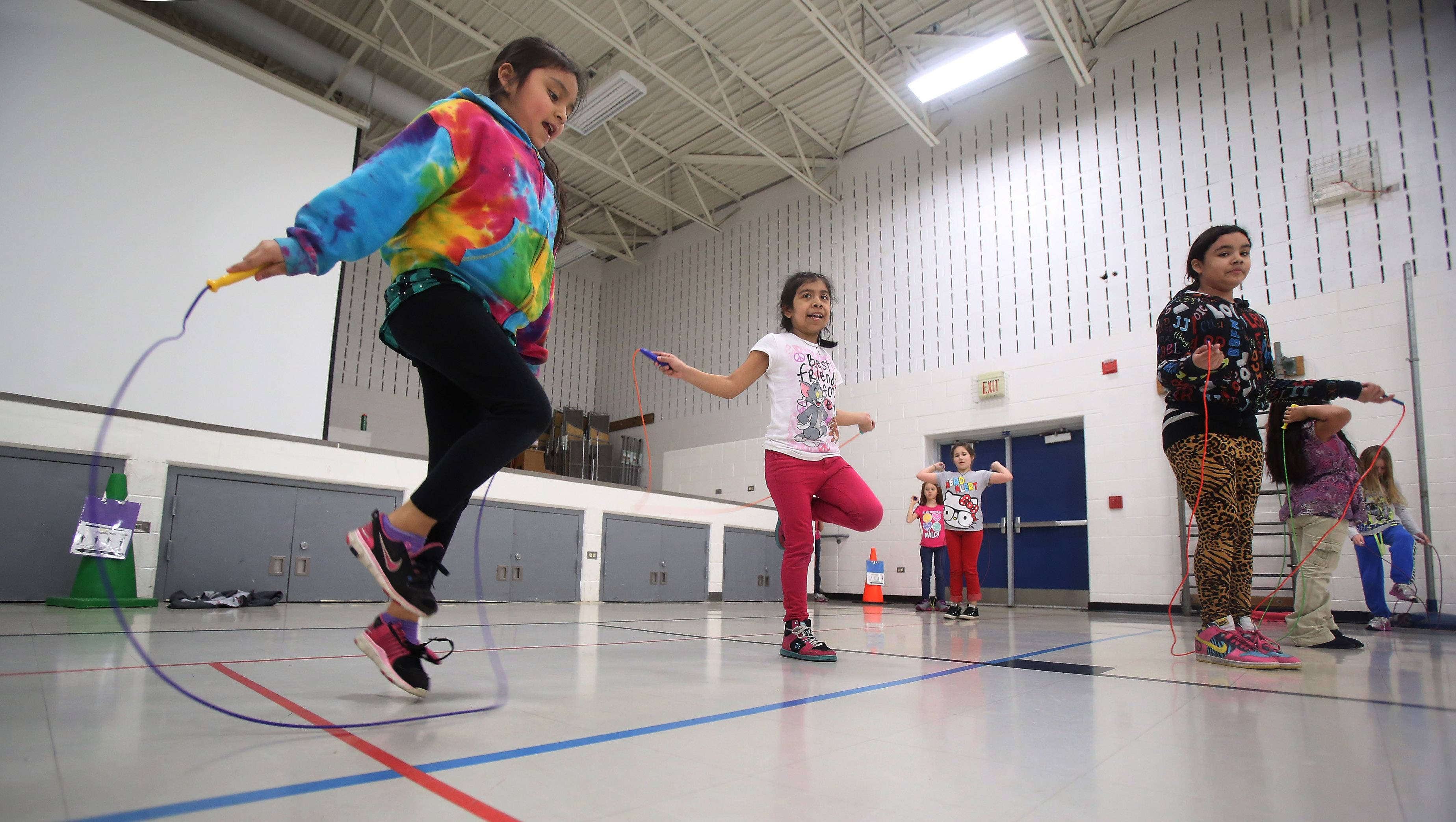 Third-graders Daaylin Bustos, left, Alejandro Guzman and Kassandra Bueno jump rope as part of Jump Rope for Heart on Tuesday at Mechanics Grove School in Mundelein. Students in third through fifth grades raised money for the American Heart Association.